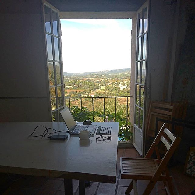 View from the studio... the mistral has driven me indoors to  @artsinprovence studio. But moving on later to let @vickinormanart teach colour . . #todaysoffice #arts #in #Provence #France #studio #artstuduo #roomwithaview #balcony #farmland #digitalnomad #remoteworking #travelandwork #travelandlife #travel #WordPress #adobe  #videoedit #lifeisbeautiful #ig_countryside #colour
