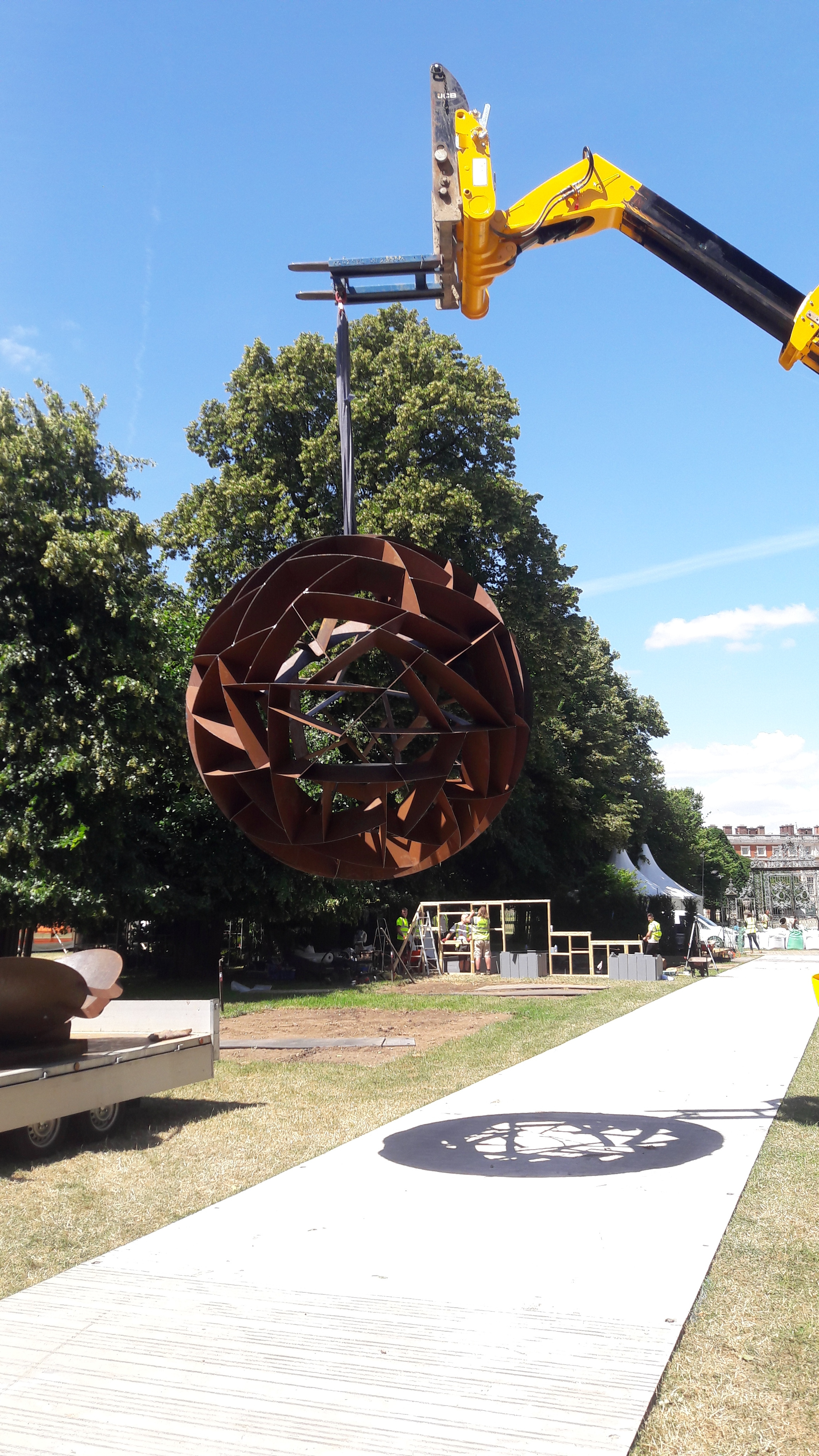 The 2.5m Corten steel sphere, weighing close to 600kg, being lifted into place.