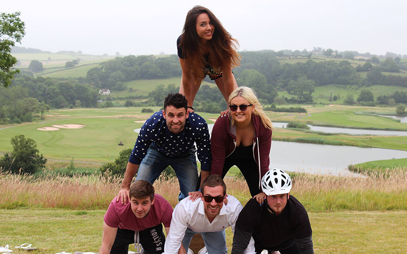 Something about a stable base… or standing on the shoulders of giants? amber did a human pyramid, it was all the rage in 2014.