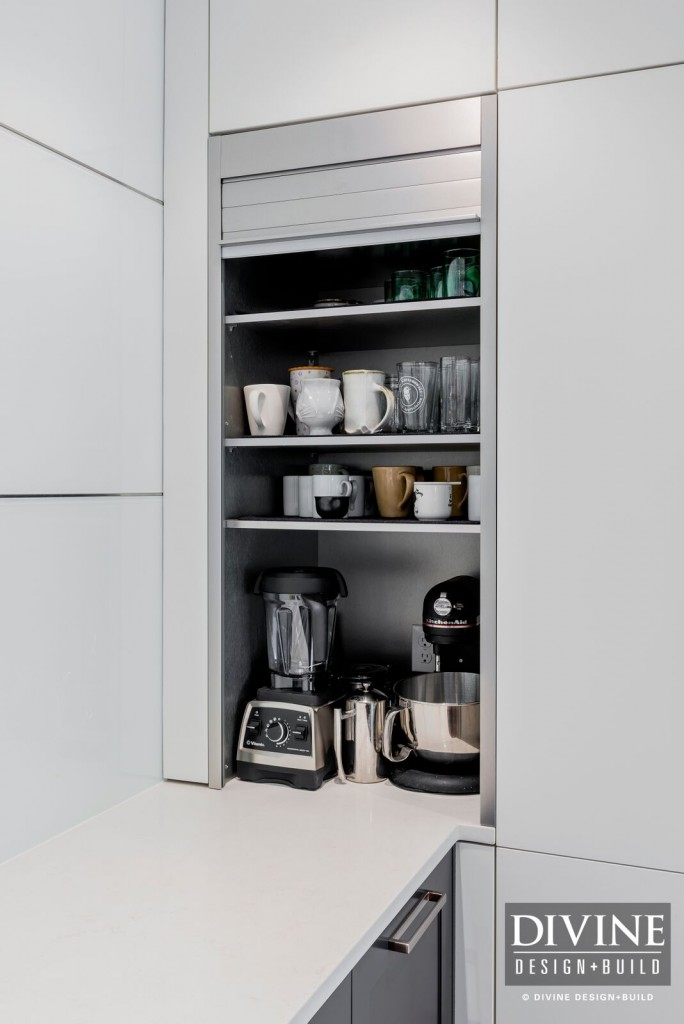 An appliance garage makes it easy to access heavy or cumbersome kitchen gadgets.