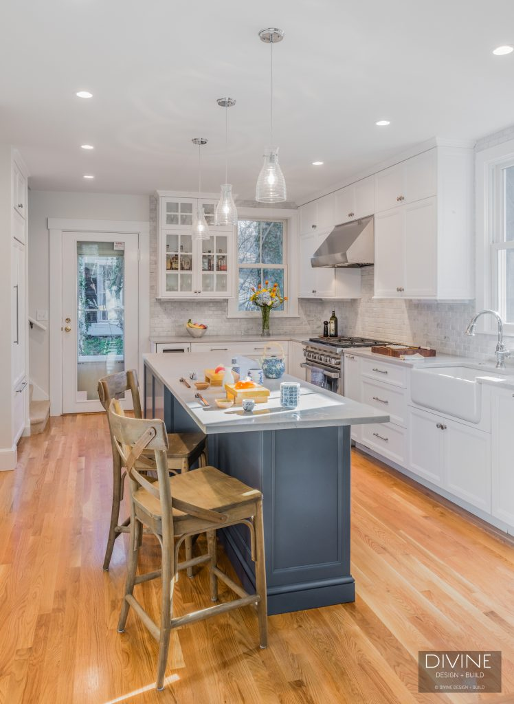 Transitional design, a neutral color scheme, high-end appliances and engineered stone counters make this kitchen prime for resale.