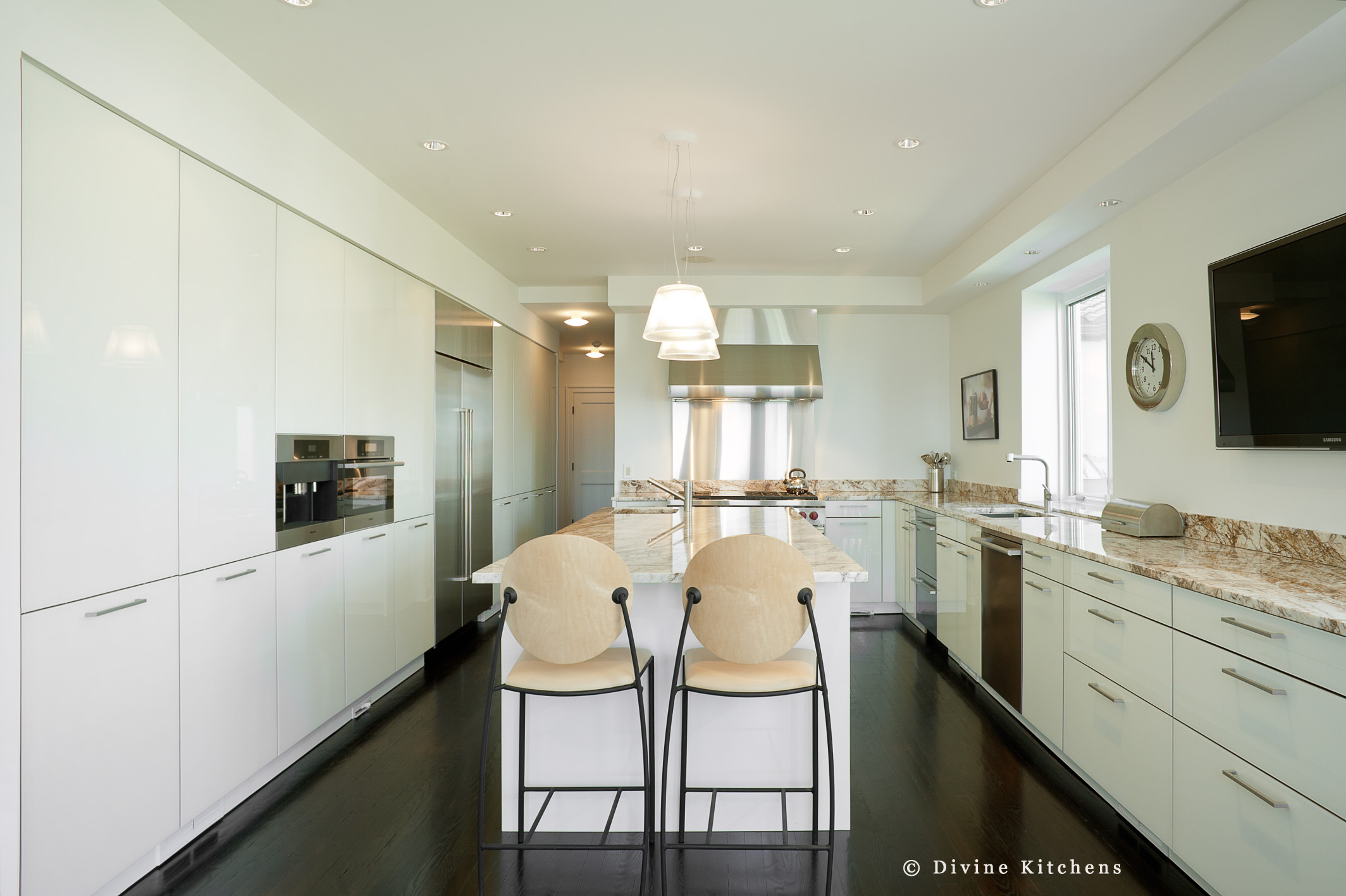 Modern leicht kitchen with high gloss lacquer cabinets. Marble countertops and wolf appliances.