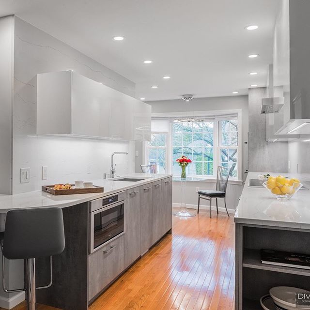 We've transformed a lot of homes into ideal spaces. This home in #WalthamMA is one of our favorites.⠀ .⠀ .⠀ .⠀ #divinedesignbuild #modernkitchen #interiordesignboston #bostondesigners #kitchendesign #contemporarydesign #contemporarykitchens
