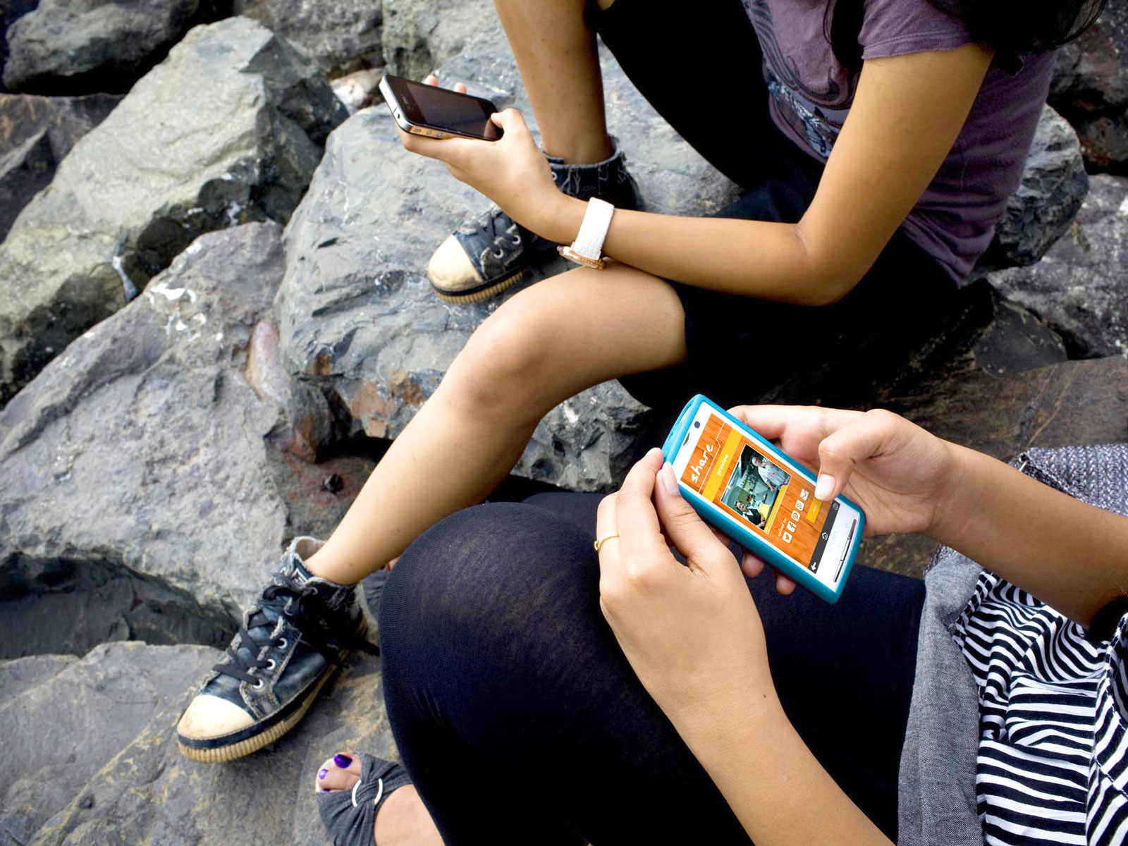 students-holding-smartphone-by-Kainaz-Amaria_1600x1200.jpg