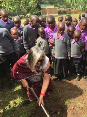 Anne planting a seedling at the Nailepu Academy