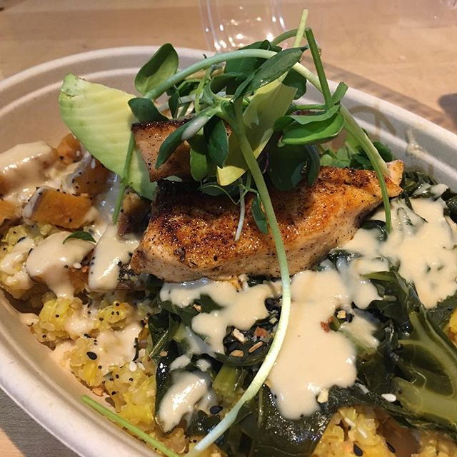 What's for lunch? • • Us? 🥙 Brown Rice & Quinoa cooked in a Tumeric broth + braised collards + roasted sweet potato + House tahini sauce + avocado + @littlewildthingsfarm micros/shoot salad + @dcfishwife fresh salmon 😋 Yep...we're #winning with this bowl full of goodness!  #eatlocaldc #grainbowl #eattogive #eatfresh #localeats #gourmettogo #madeindc #unionmarketdc #dceats #sourcelocal #buylocal