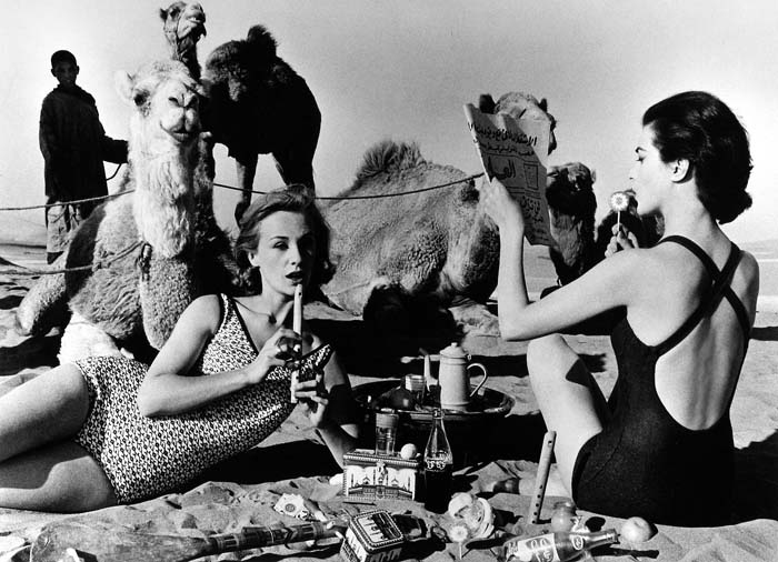 © William Klein: Tatiana + Marie Rose + Camels, Picnic, Morocco, 1958