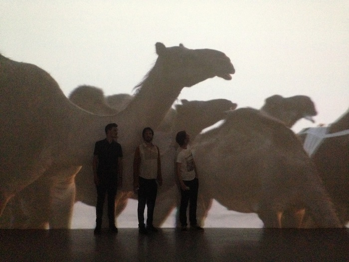 Mark Minkjan, Michiel van Iersel, René Boer in front of Wael Shawky's Dictums: Manqia I video installation
