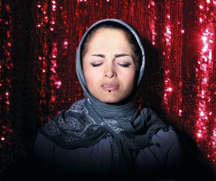 © Newsha Tavakolian - Listen - Singing woman
