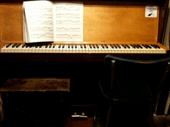 © Hind Mezaina - A reading room inside Shakespeare and Company. People can play on the piano if they like.