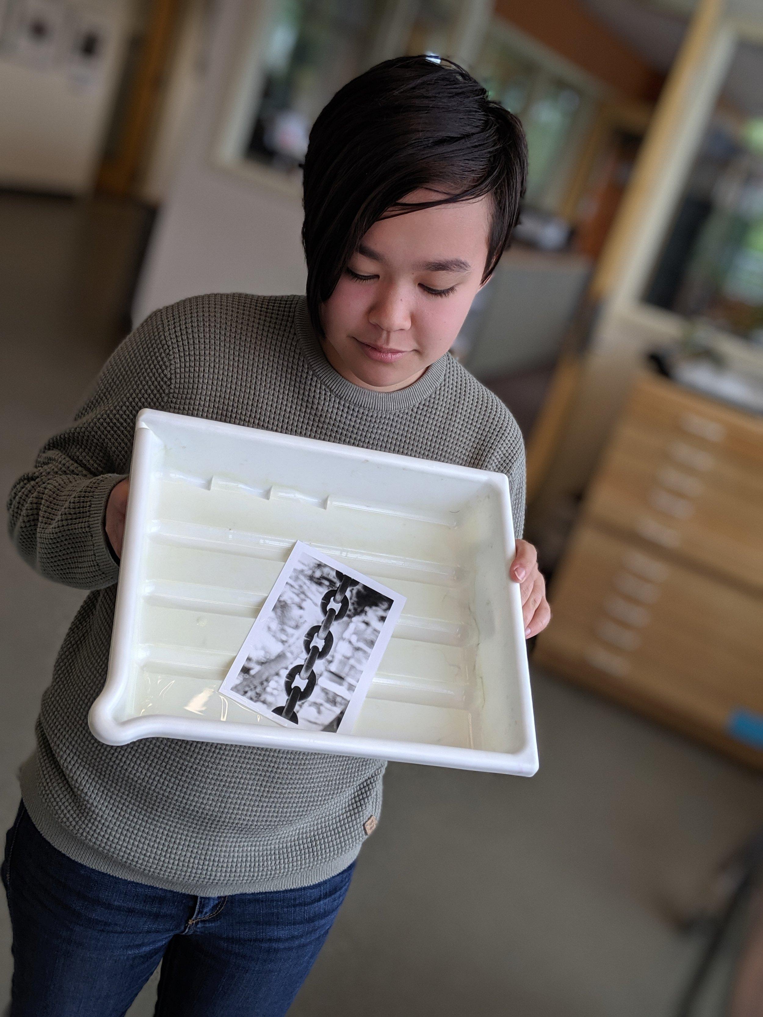 Audrey shows us her first darkroom print.