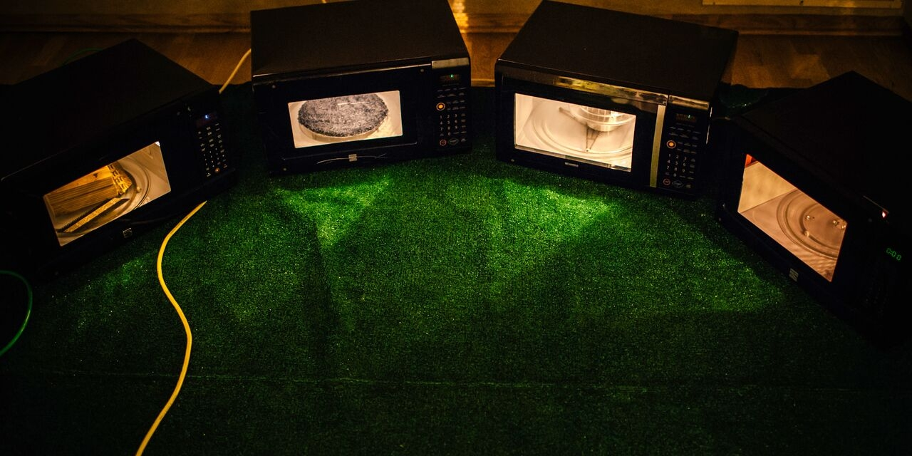 Kristin Richards,  dwellings , 4 modified and running microwaves with building materials, extension cords and artificial turf, size varies based on installation, 2014