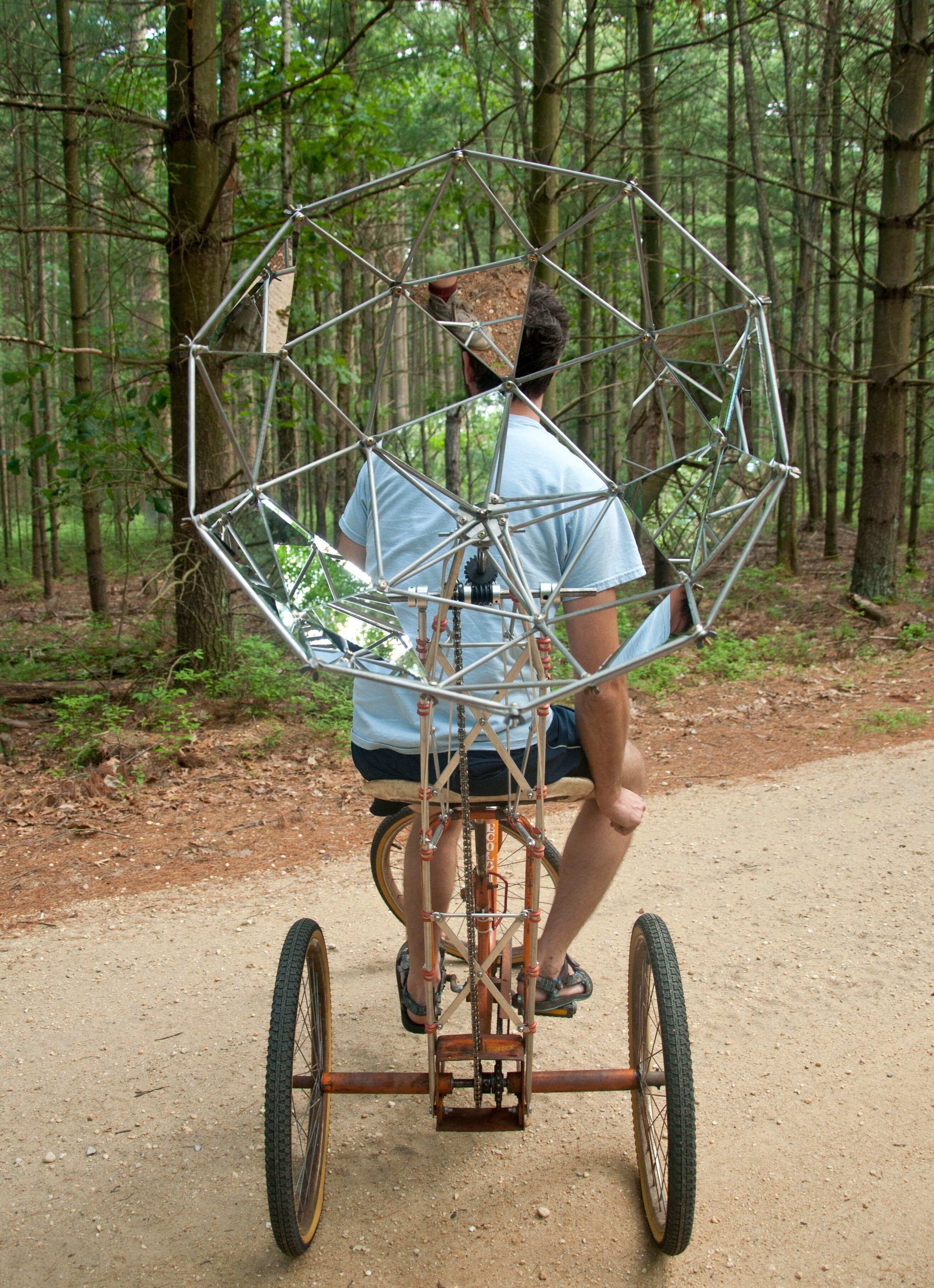 Nate Ricciuto,  A Stable Foundation , 2016, Mirrored glass, aluminum, fasteners, tricycle