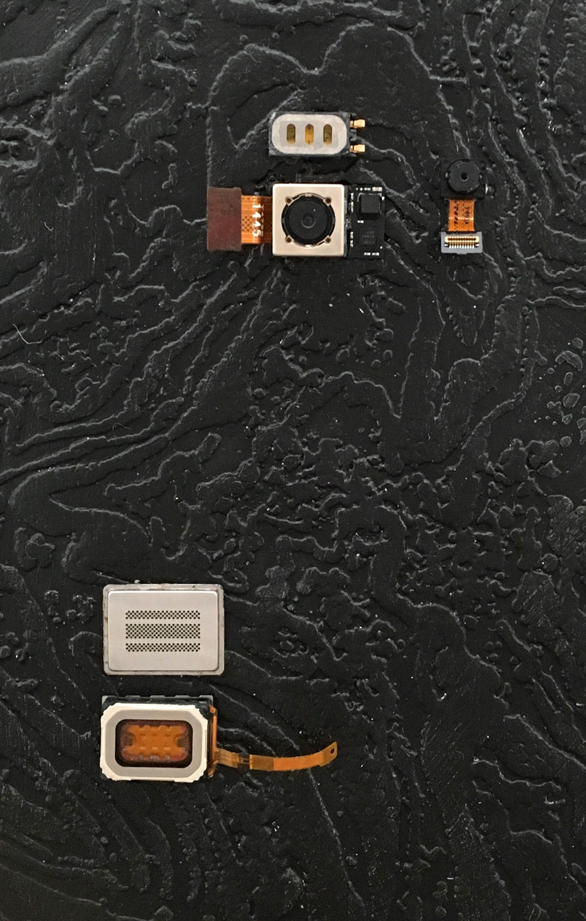 """Corey Conell,  Back to Black (After Snowden) , 2016, Cell phone cameras mounted on enamel painted wallpaper, 7x5""""."""