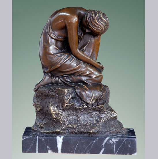Woman in meditating in bronze.jpg
