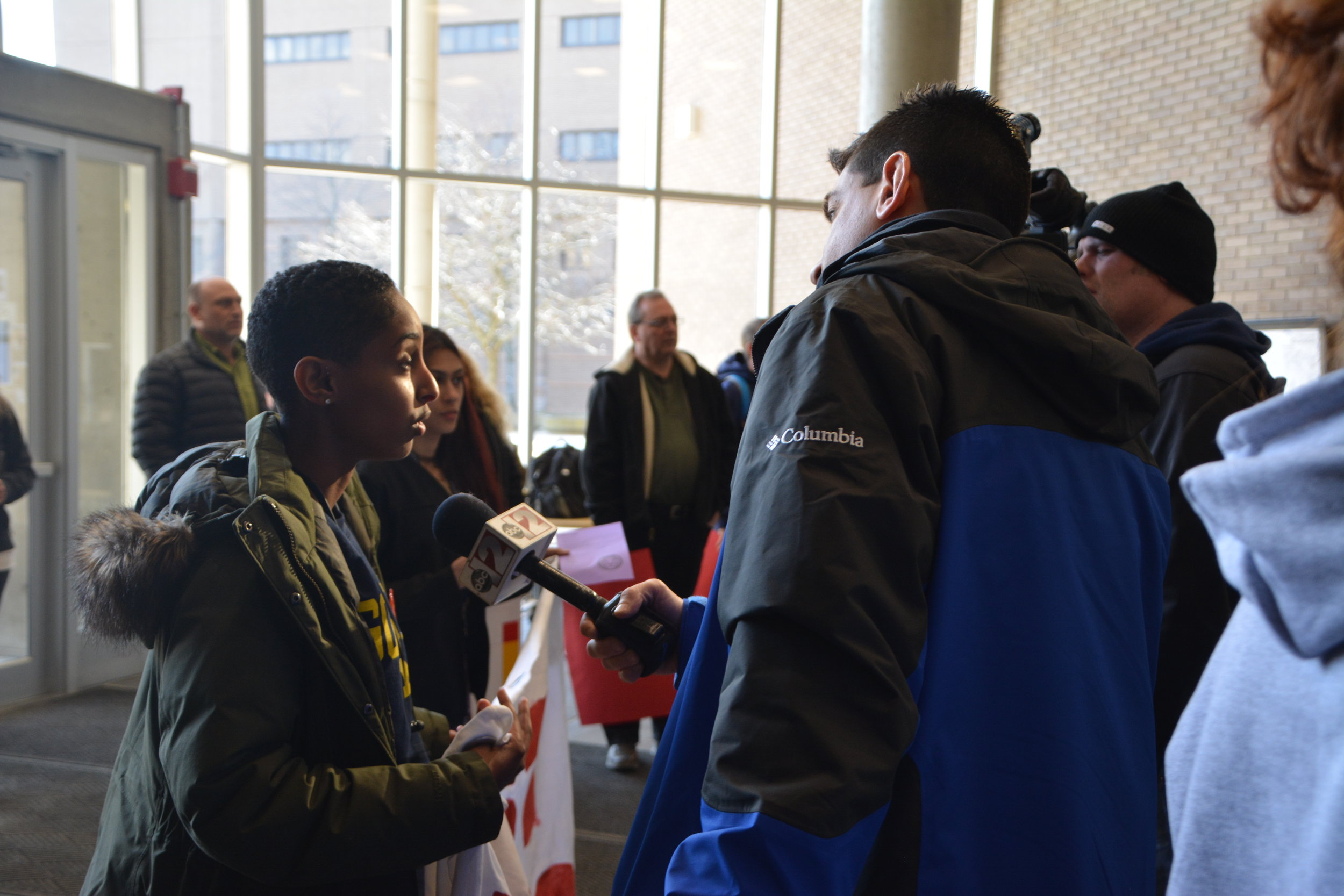 A UM Flint student ally speaks to the press about LEO contract negotiations in 2018