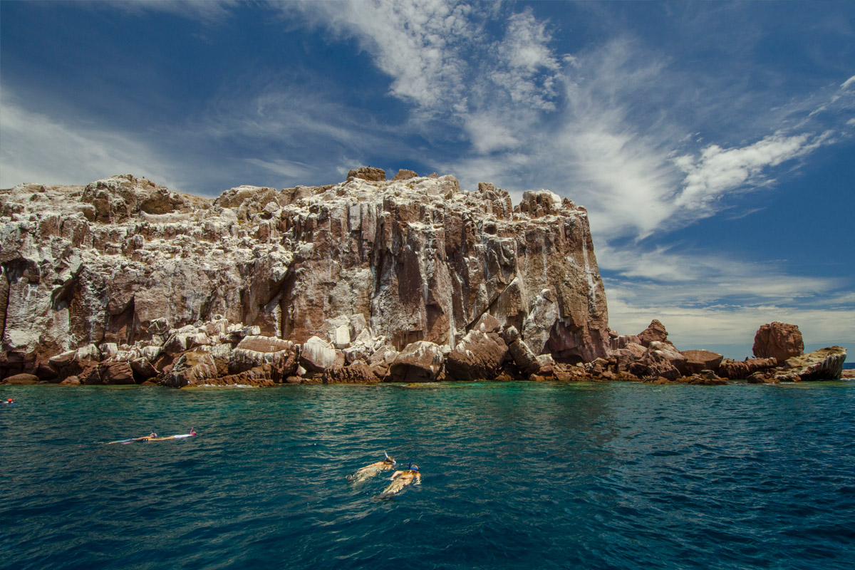 Have a picnic lunch on Espiritu Santo Island and take a hike