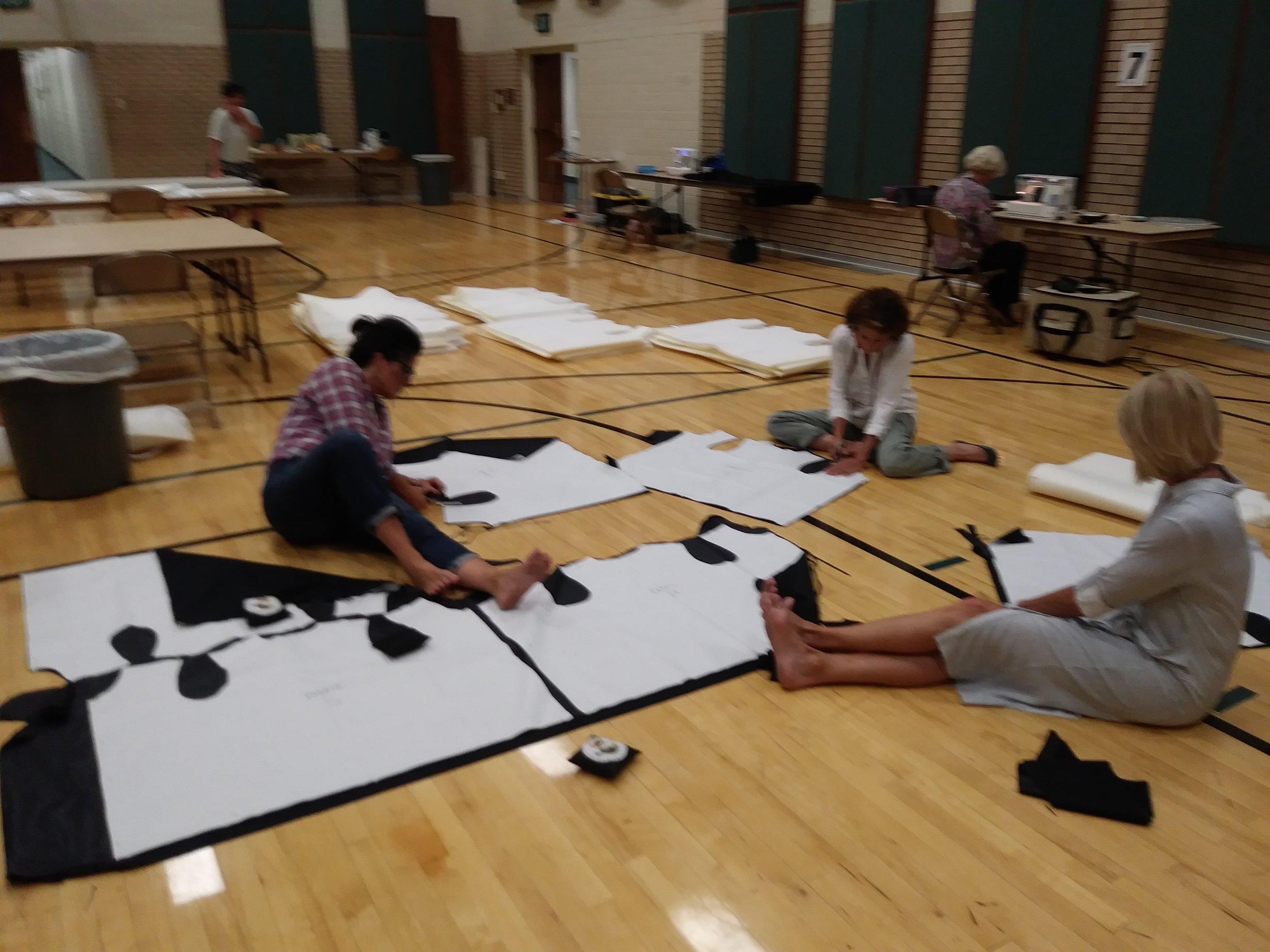 Volunteers cut out vests September 2017