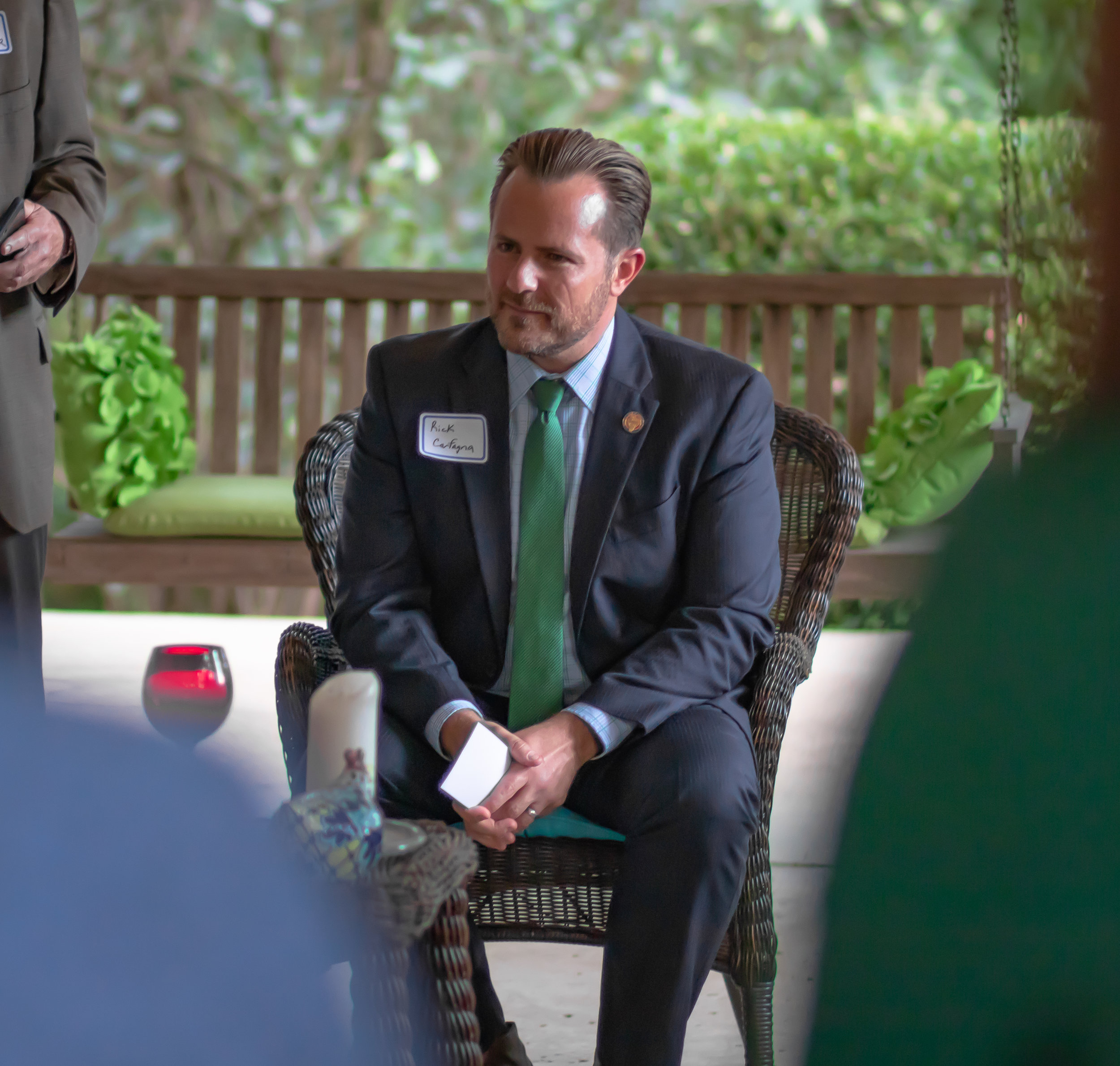 State Representative Rick Carfagna listens to medical students at Dr. Ecklar's home