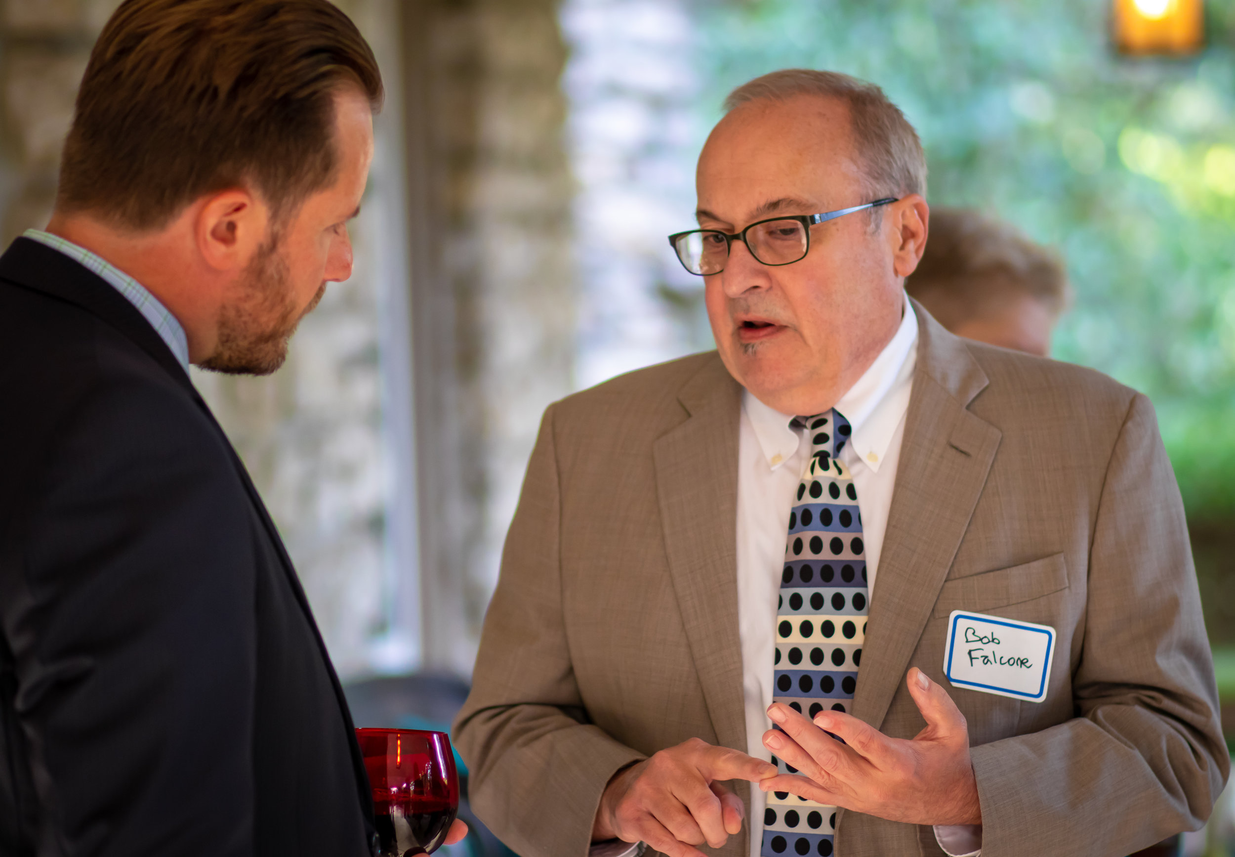 Rep. Rick Carfagna (left) speaks with Dr. Robert Falcone (right), CEO of the CMA