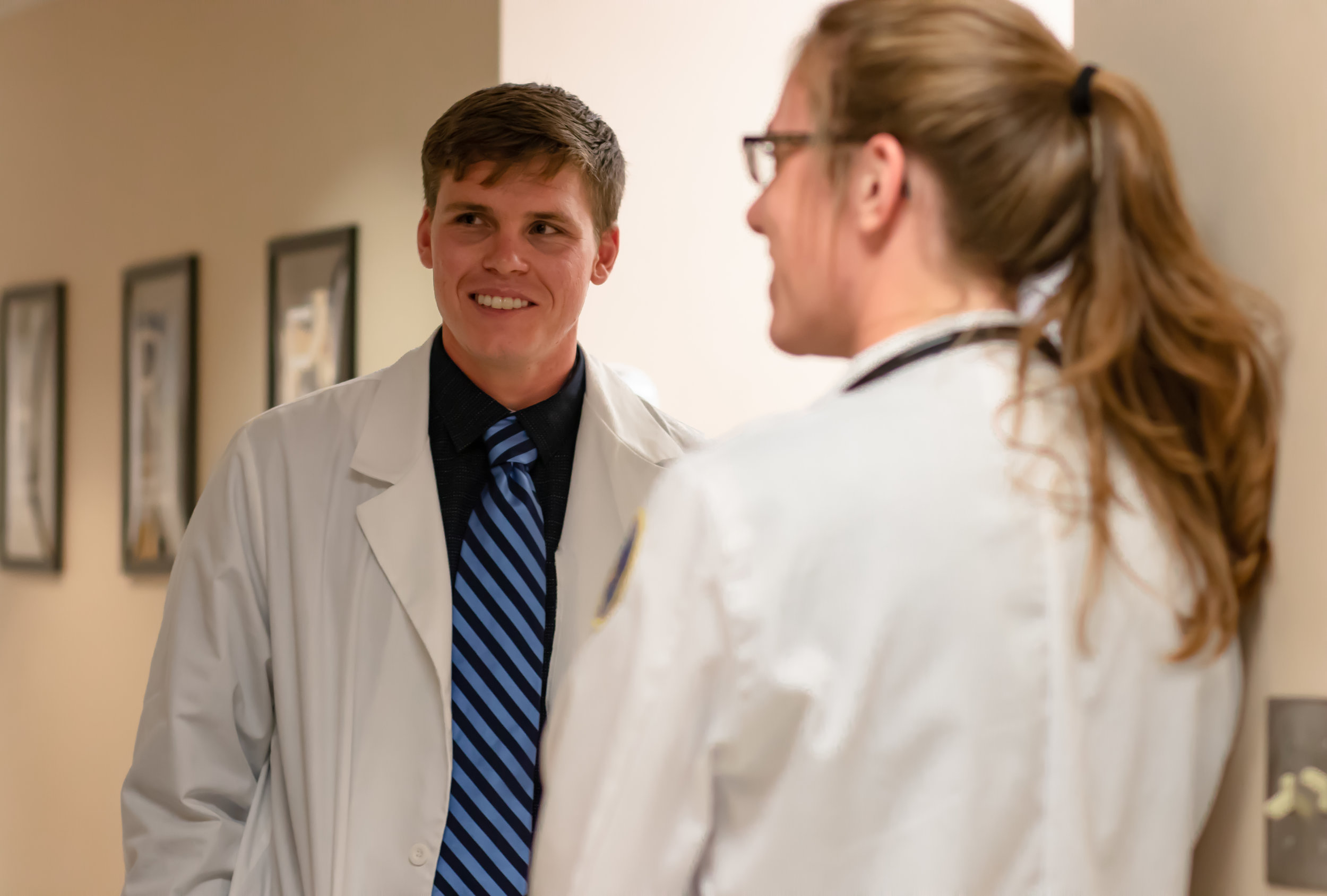 Two medical students volunteer their time at the Physicians Free Clinic