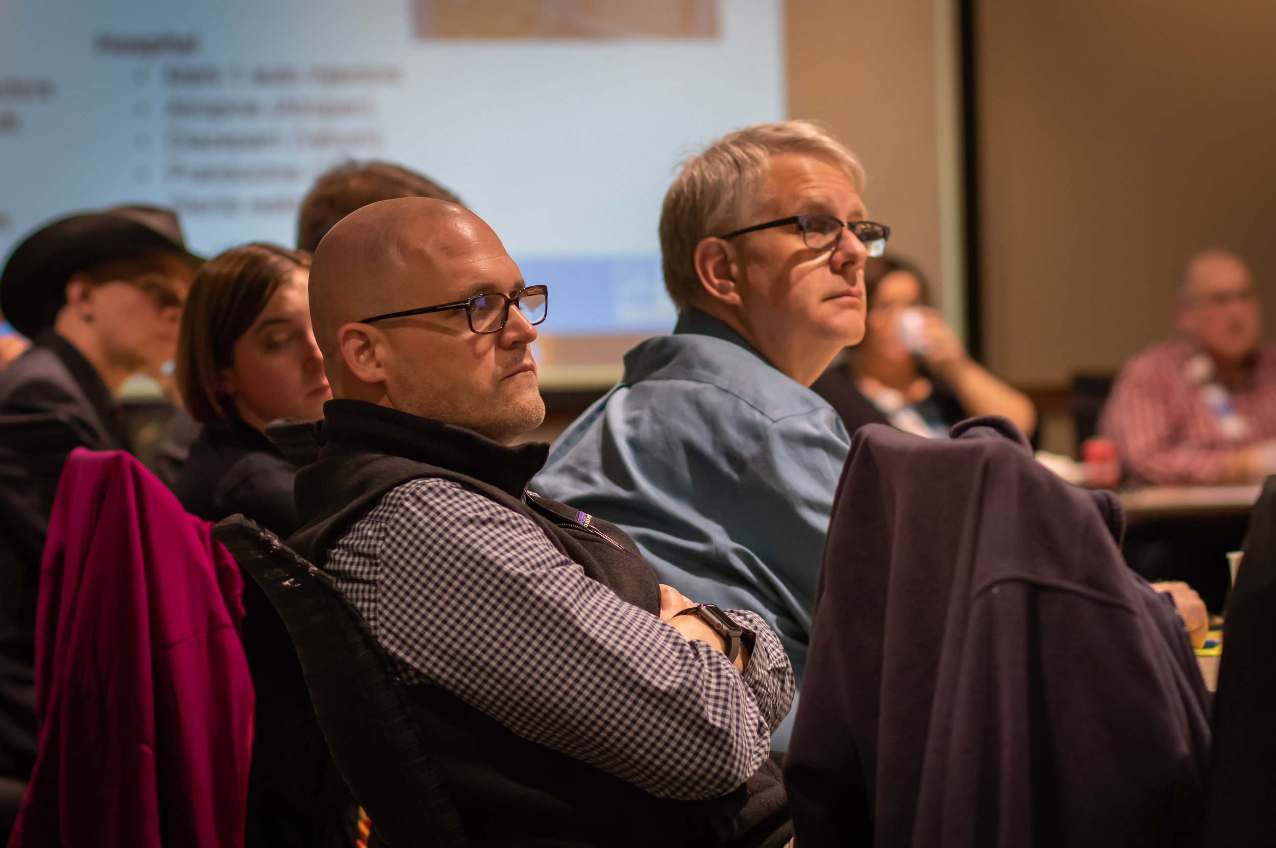 Participants of COTS Medical Countermeasures SNS training listen intently