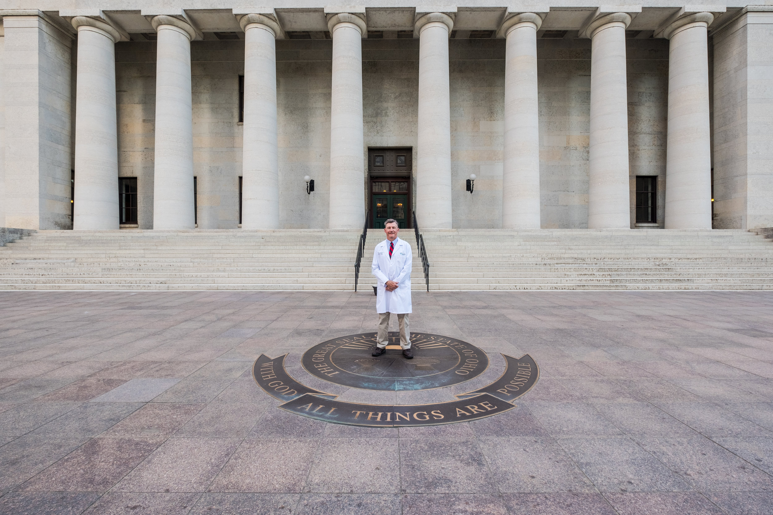 Dr. Bill Cotton (Co-Chair of the CMA Public Policy and Political Action Committee) stands in front of the Ohio Statehouse