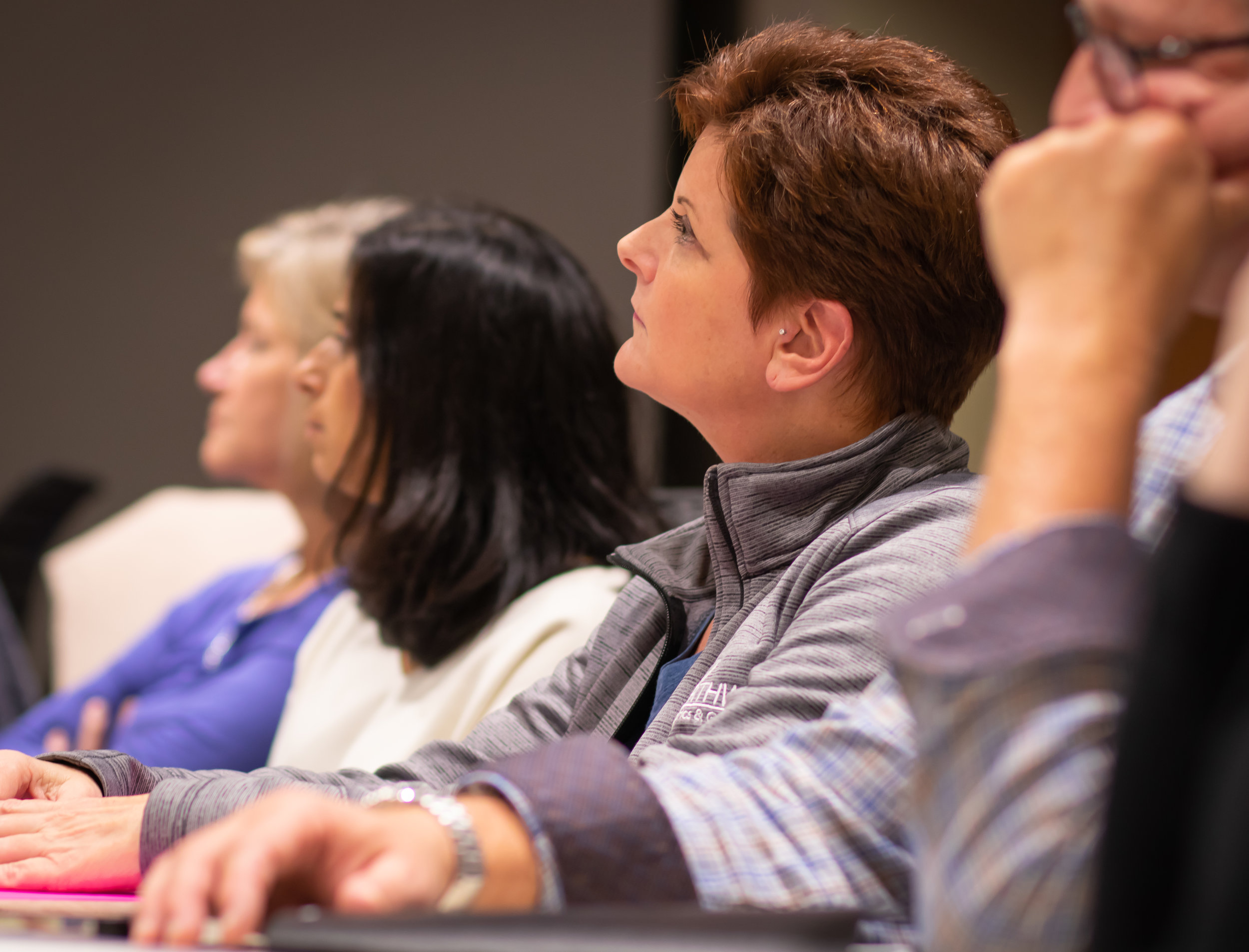 Physicians listen intently to Biehl's presentation during the November PLA session