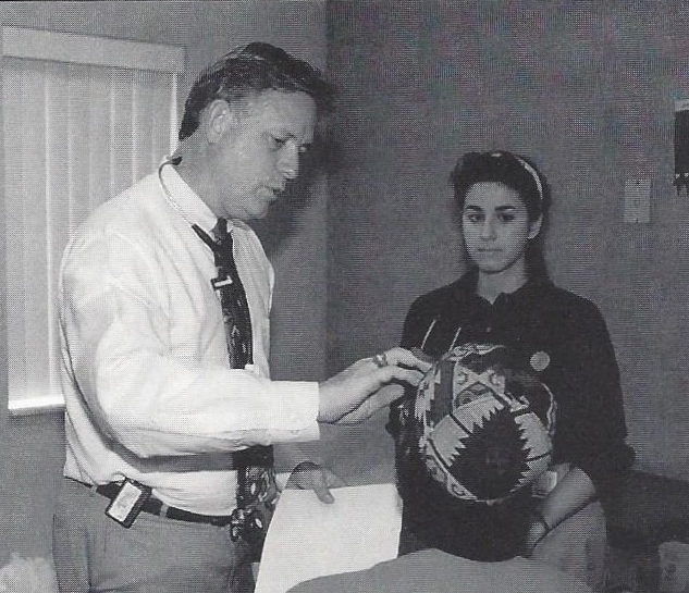 Dr. Bope assists a patient at the Physicians Free Clinic, 1995