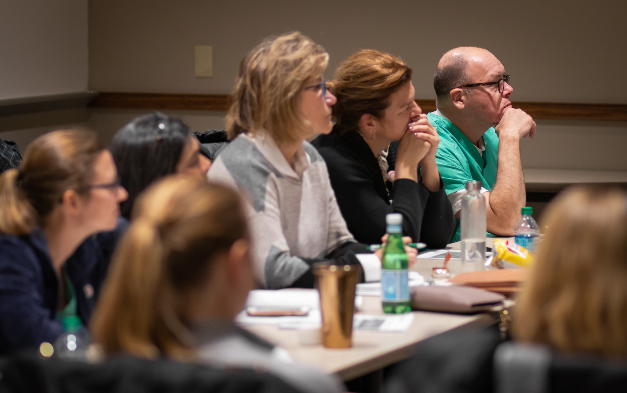 Doctors listen to a presenter during December's PLA class session