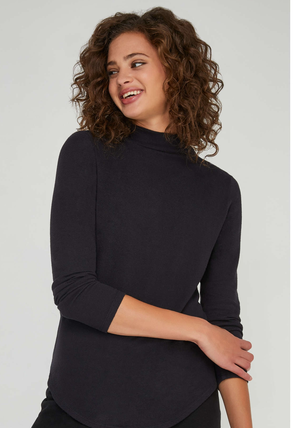 Basic long sleeve cotton turtle neck from Joe Fresh. This top goes for $24