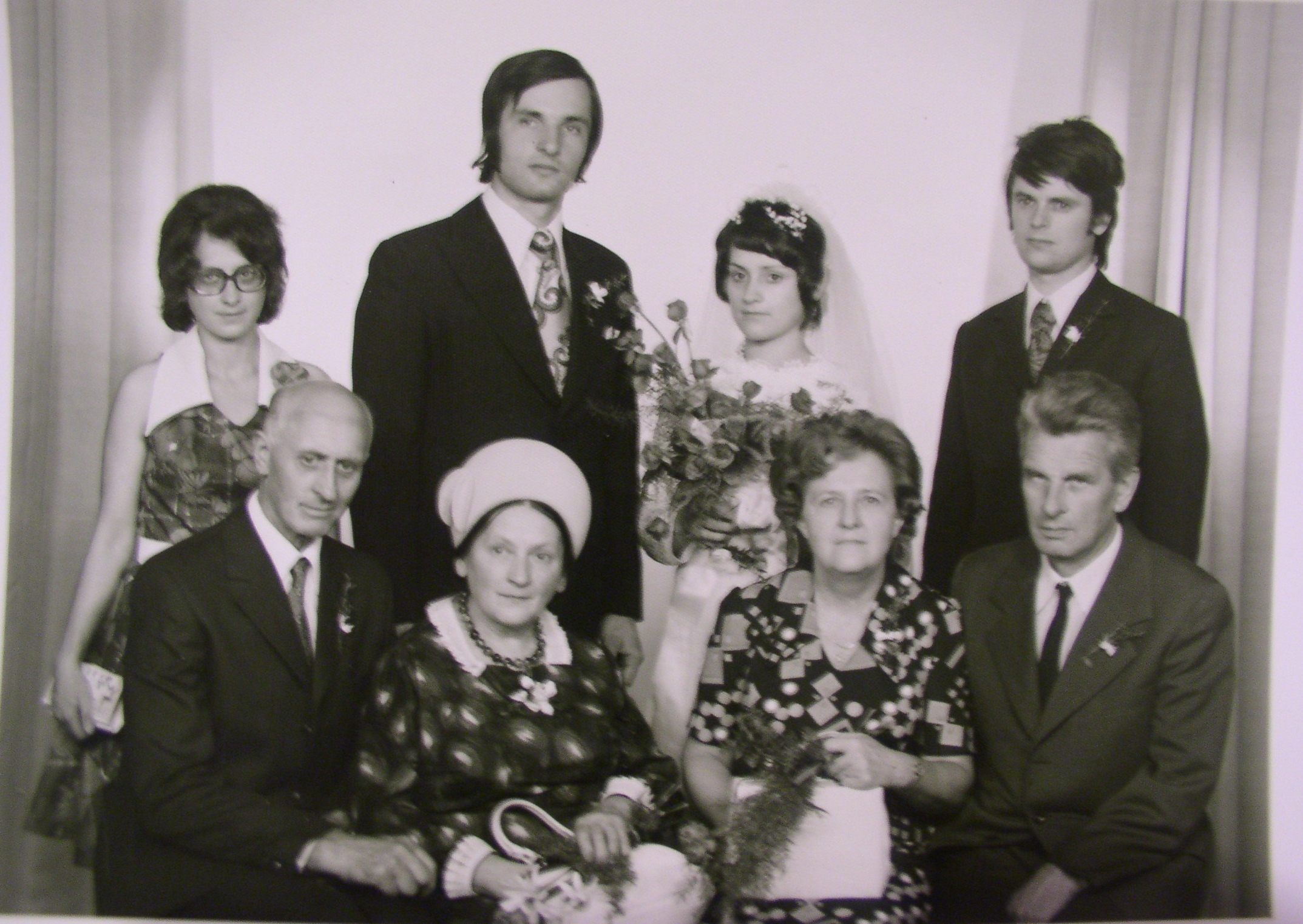 Author on her wedding day, with her mother second from the left