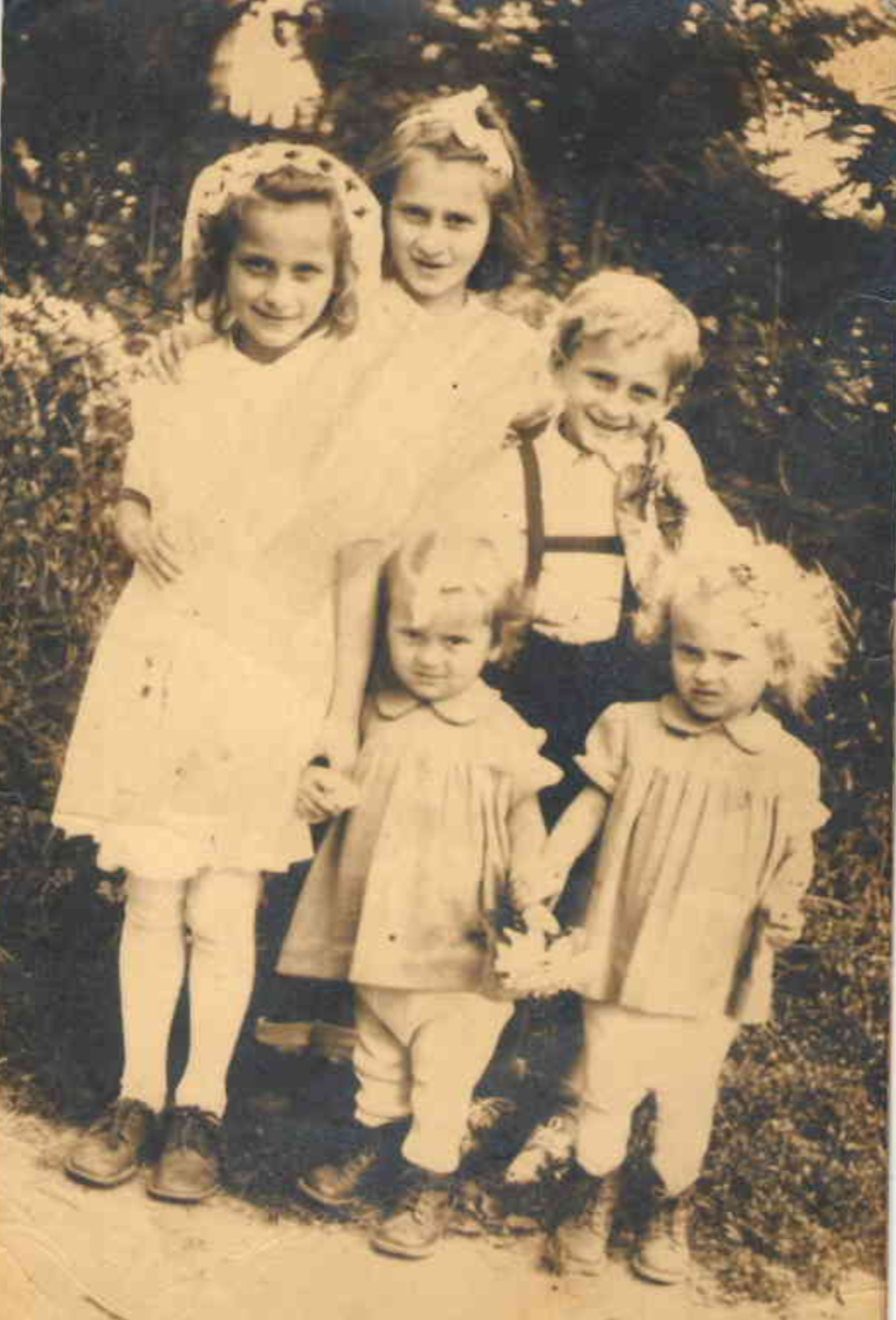 Author, bottom center, with her siblings, 1953.
