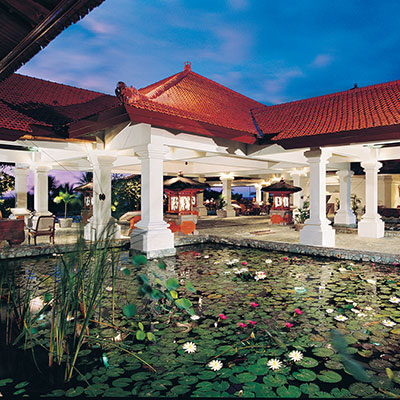 "GRAND HYATT BALI    Bali, Indonesia   Inspired by the Legendary Palace of Tirta Gangga in Karangesem, this unique Water Palace concept presents four-storey ""low-rise villages"" on islands surrounded by lakes and sand banks. The 750-room resort is spread out on 40 lush acres of serene lily ponds, waterfalls, rivers and carp filled lagoons."