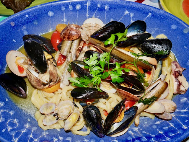 Il Chiostro, Amalfi dinner, homemade fusilli with mussels clams and little lobsters with fresh sautéed cherry tomatoes in a white wine and olive oil and sauce