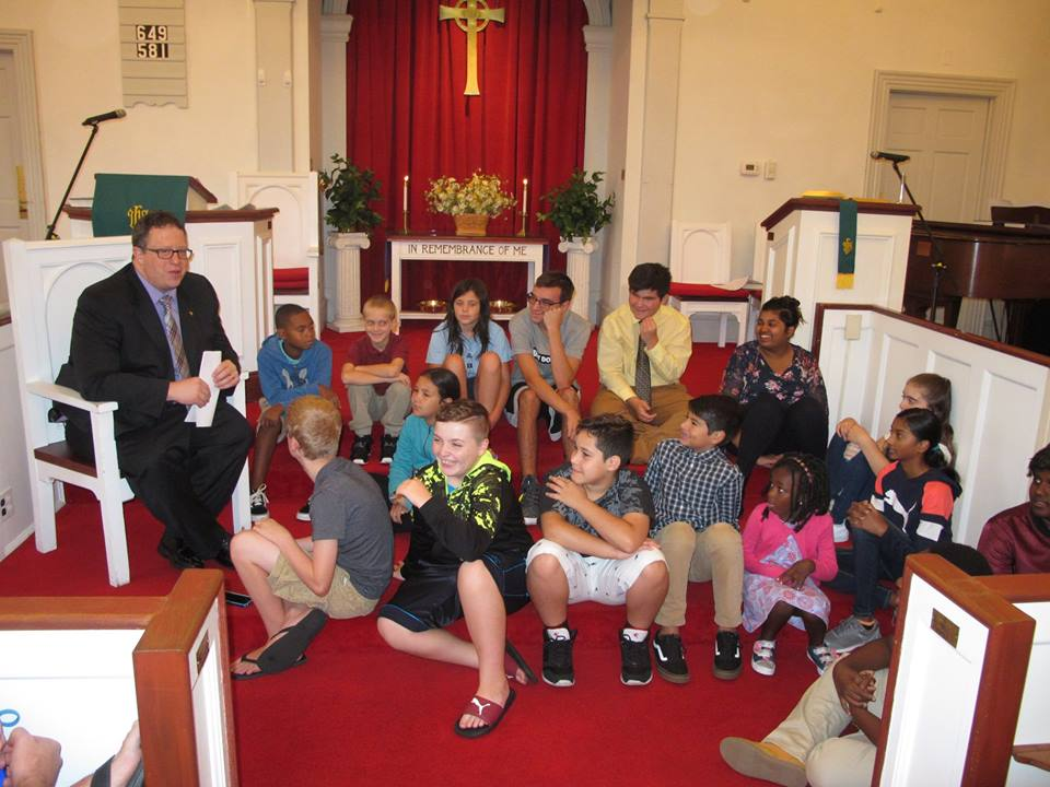 Sunday worship services feature a Children's Sermon where the children of the church come up to participate.