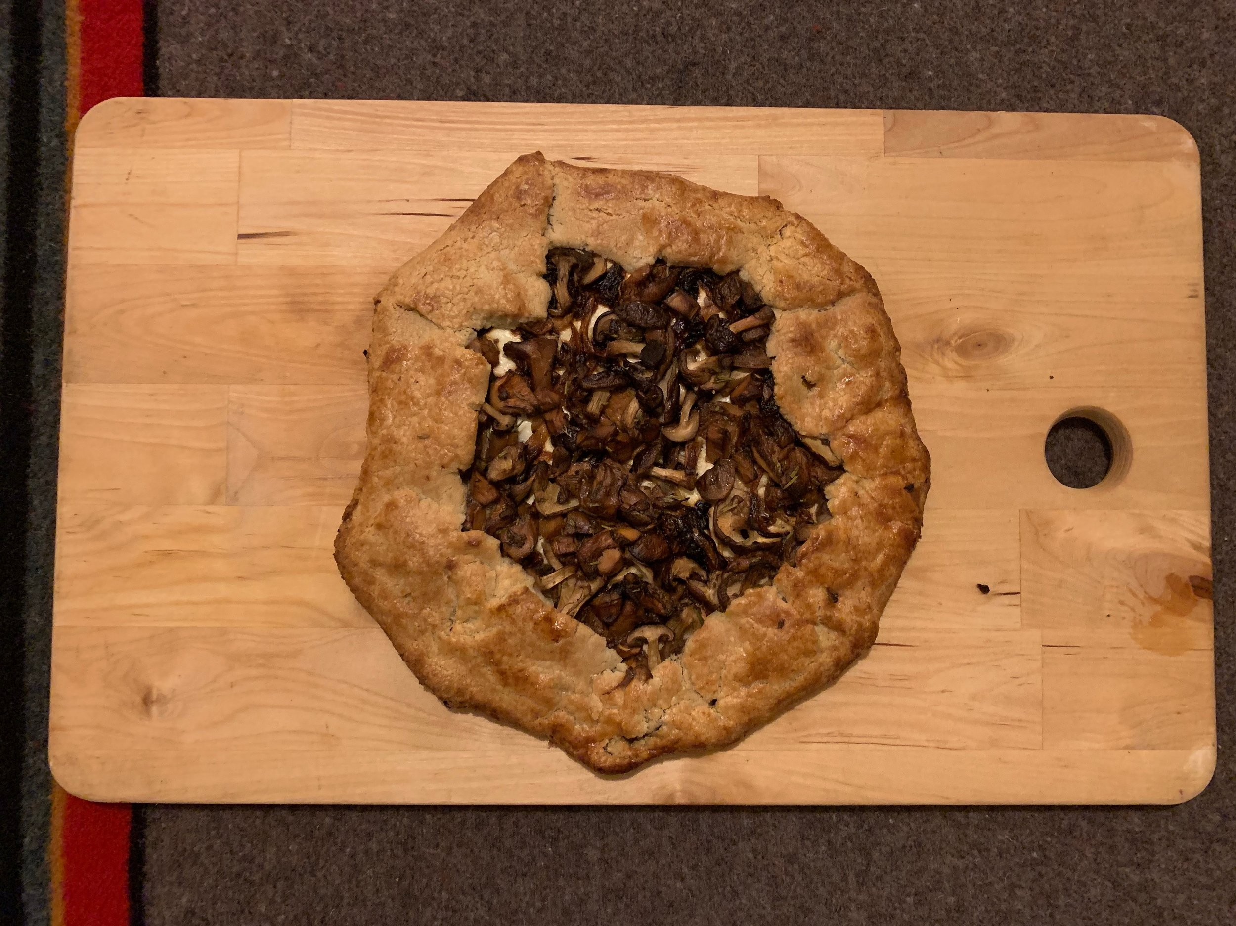 Wild Mushroom Galette - Shitake Mushroom and Caramelized Onions layered on goat cheese and buttery crust.
