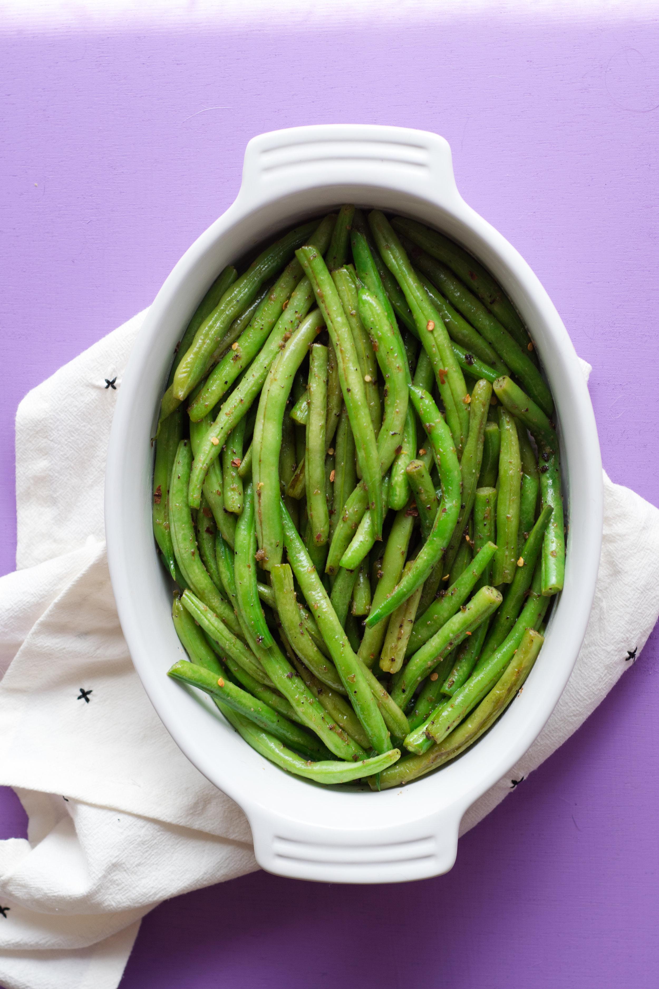 Blistered Green Beans with Horseradish Butter | shutupeatthis.com
