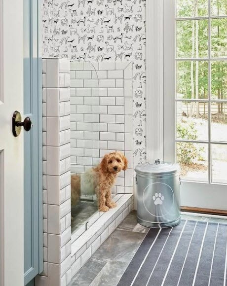 Check out the cute Thibaut wallpaper in this lighthearted laundry/utility room.