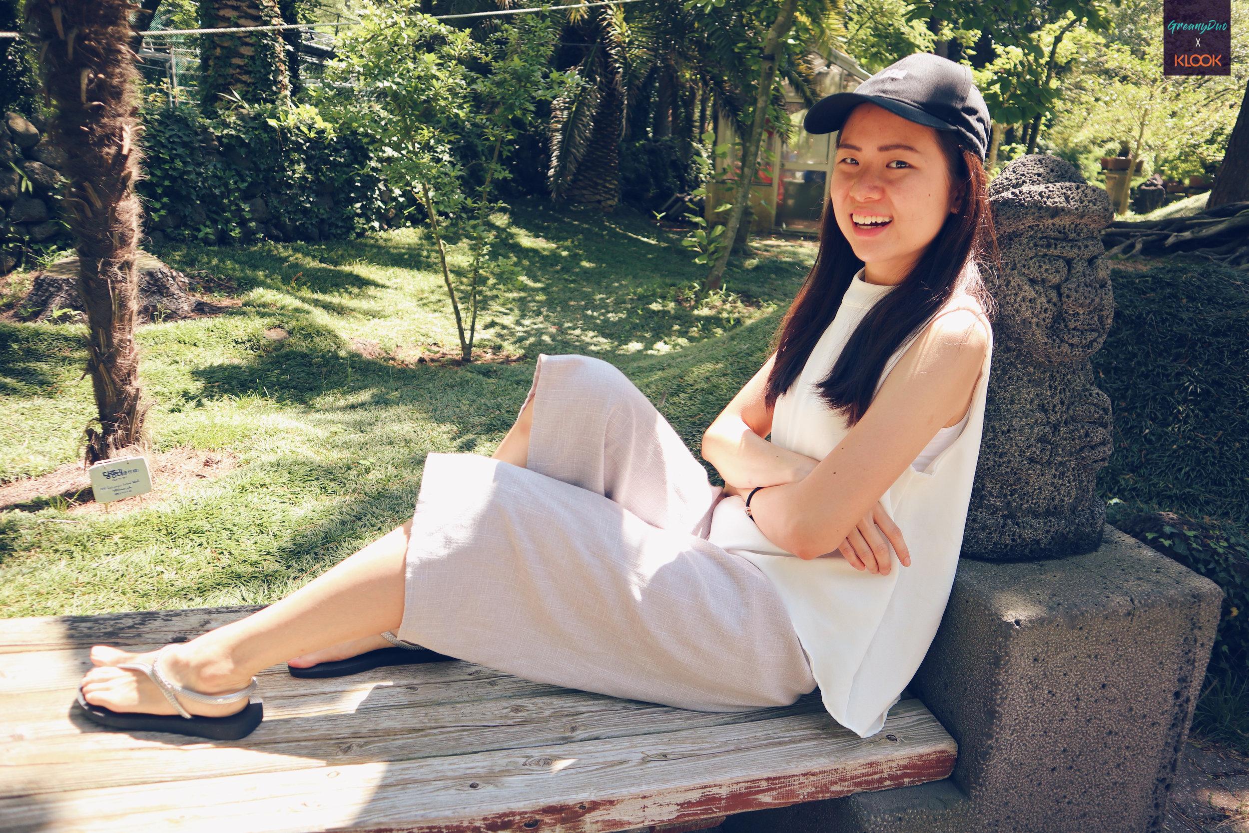 jenny posting on a bench at hallim park, jeju