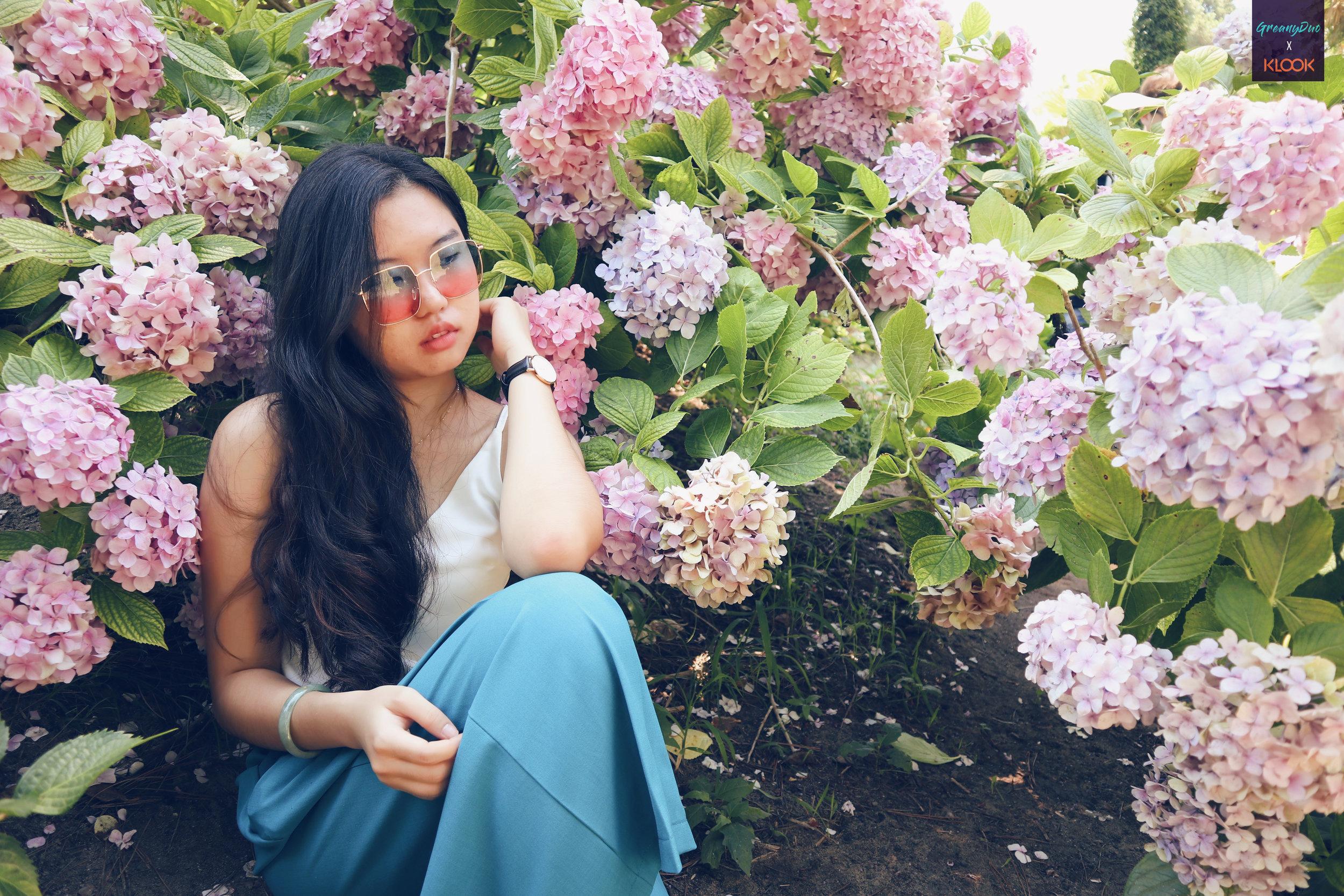 tina posting with hydranges flower at hallim park, jeju
