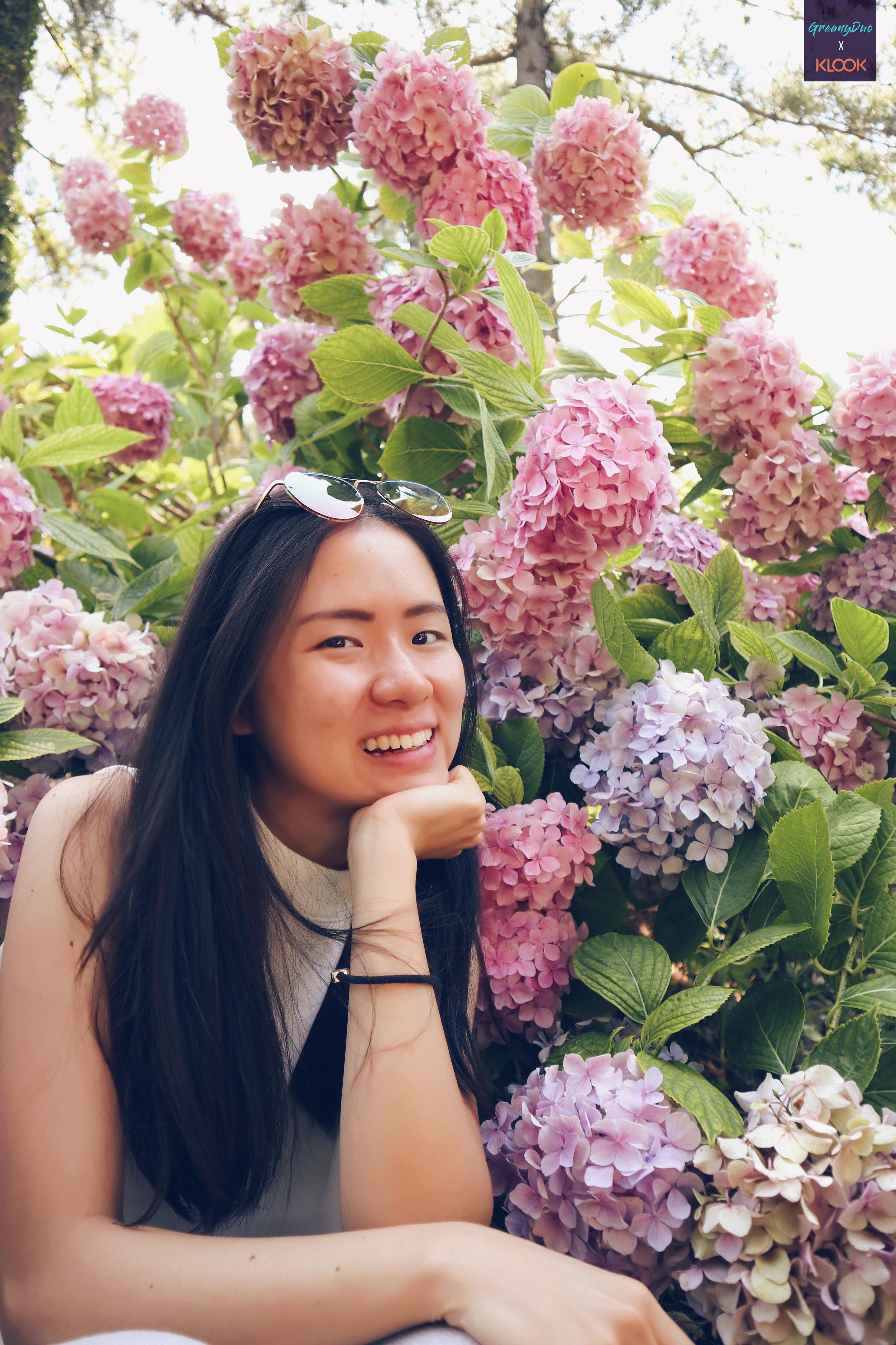 jenny posting with hydranges flower at hallim park, jeju