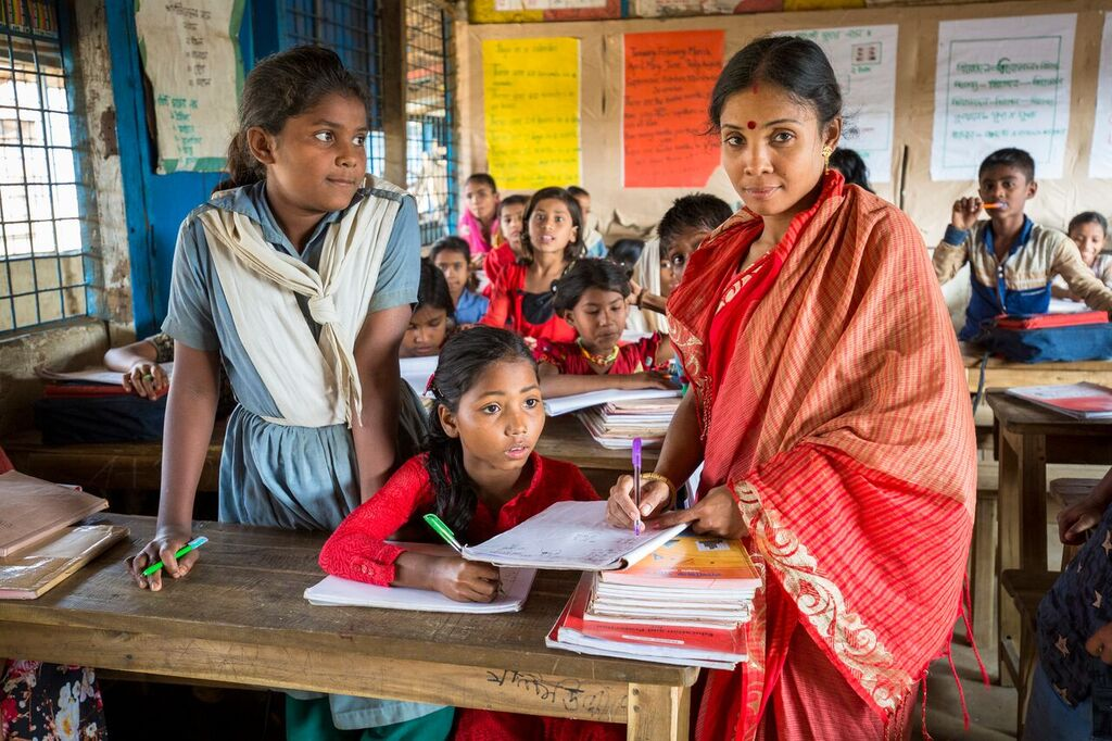 """""""People used to overlook the importance of girls education. I took it as a challenge."""" -Jubilee Barua, 30, a teacher in Kutupalong refugee camp.    Over 600,000 people, largely stateless Muslims from the northern part of Rakhine State, have fled into neighbouring Bangladesh to escape the ensuing violence.    © UNHCR/Roger Arnold"""