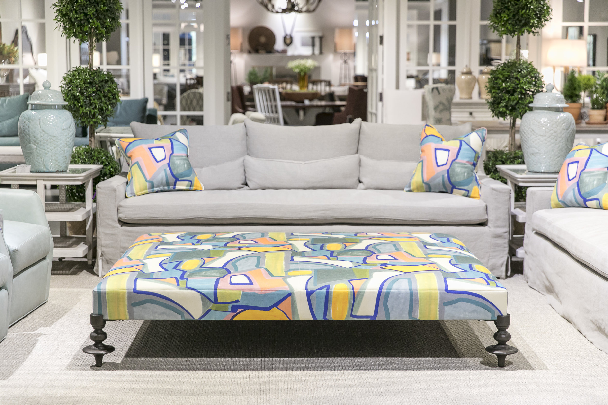 Century Showroom Vignette featuring the Boheme Ottoman and Shae Large Sofa