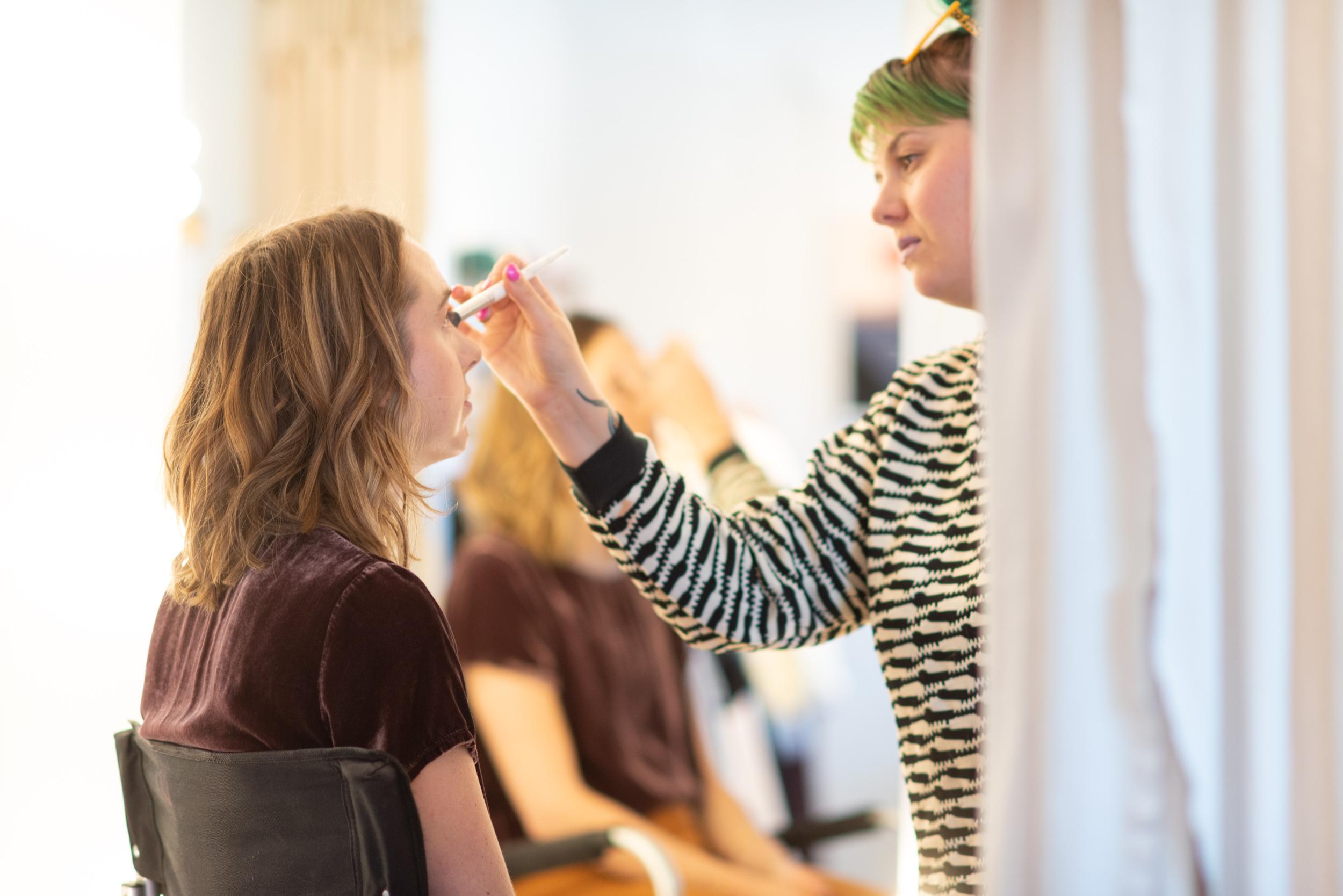 Makeup artist Noel Dalton working on Daisy
