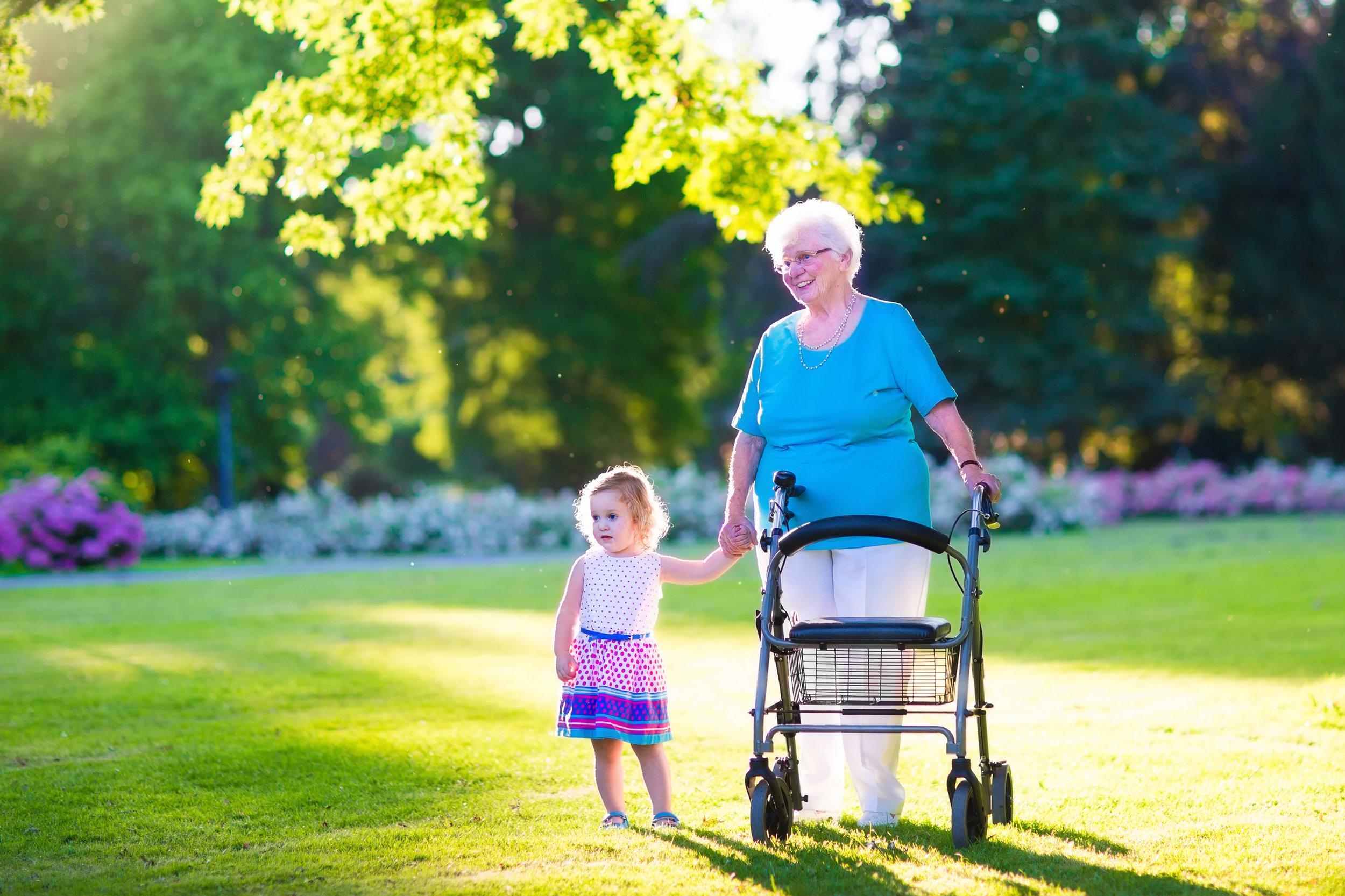 walker grandma with child on grass.jpg