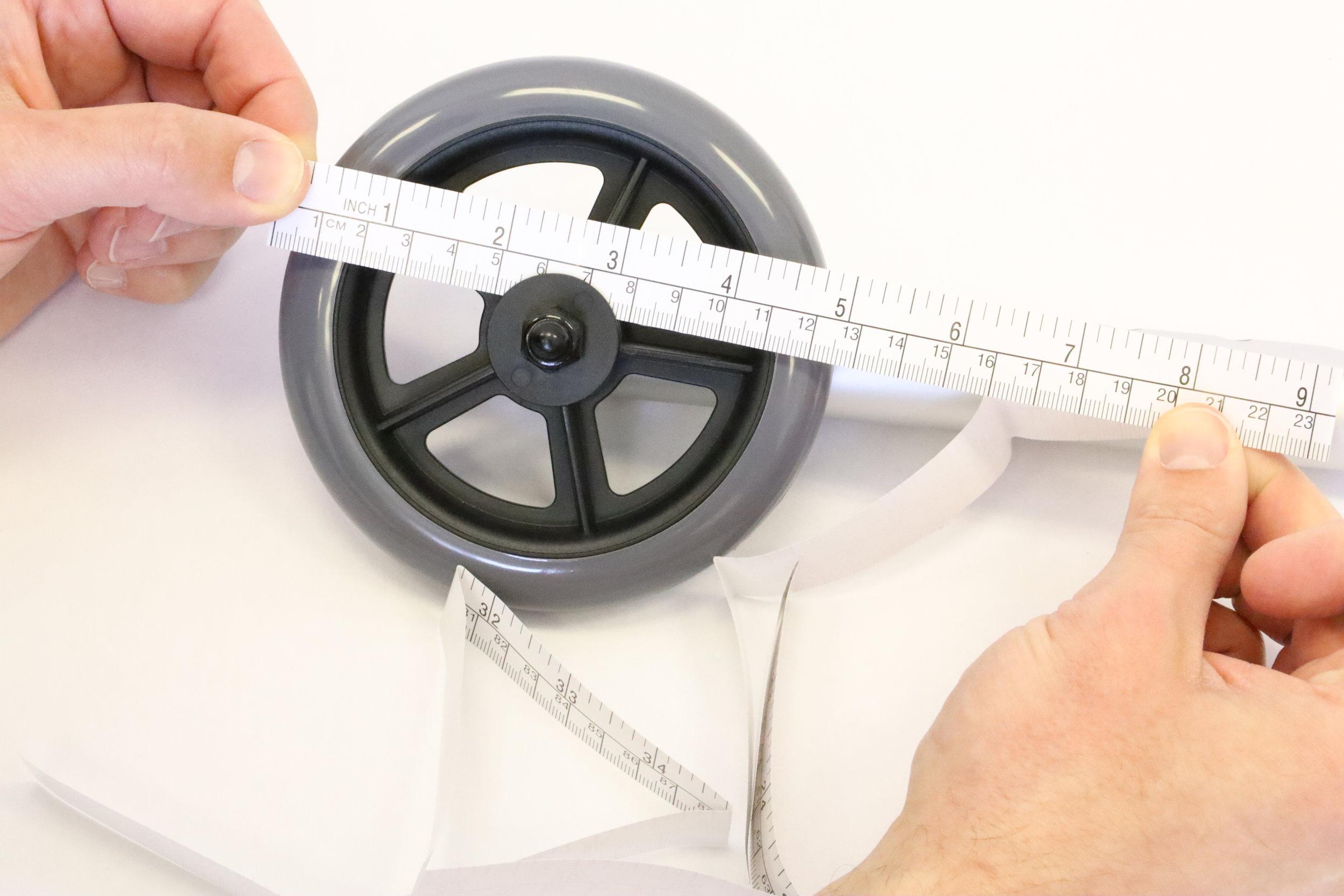 This walker wheel is about 125 millimeters in diameter (12.5 cm).