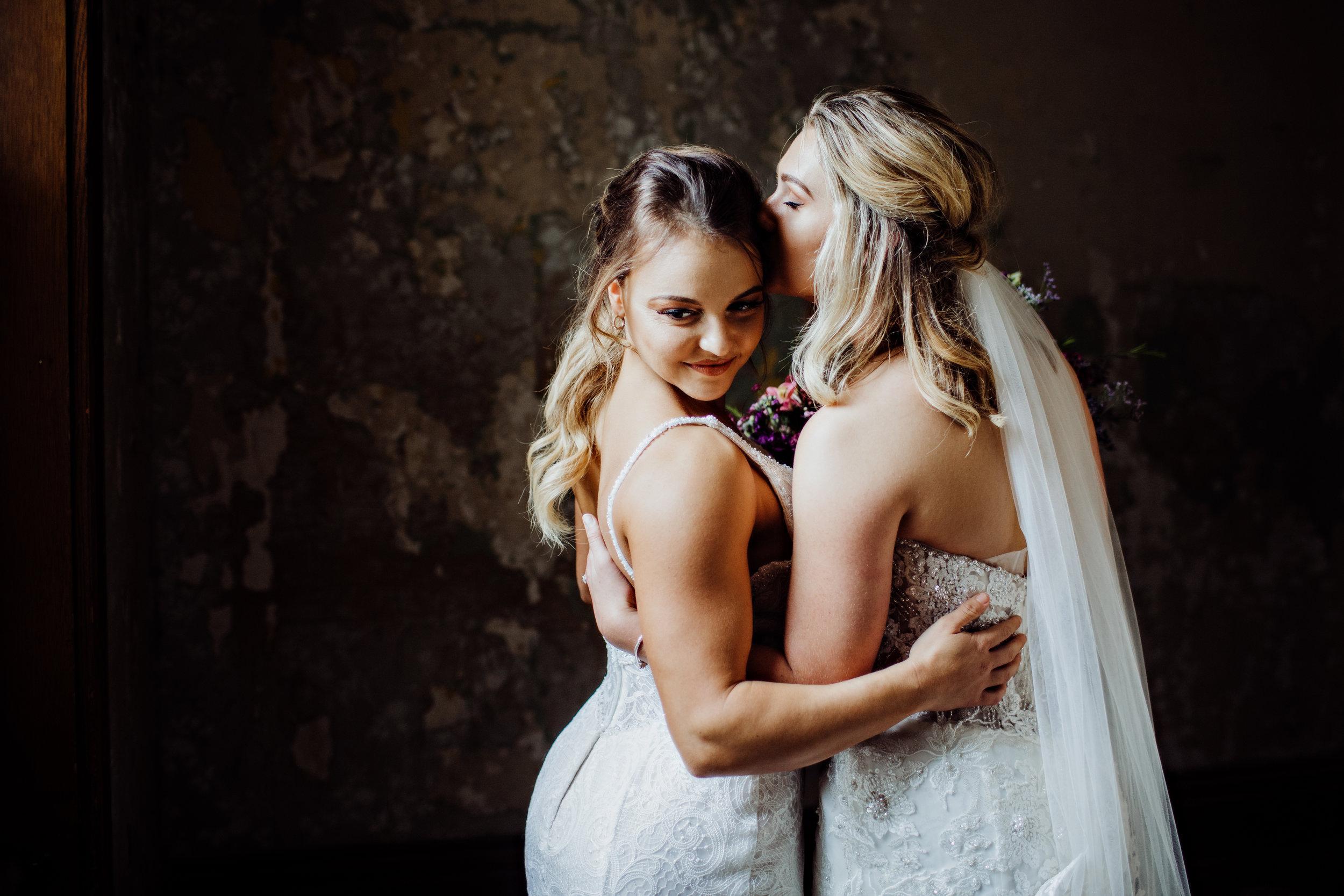 Lesbian wedding styled shoot at ohio state reformatory. wedding gowns. cincinnati wedding planner traveled to columbus.