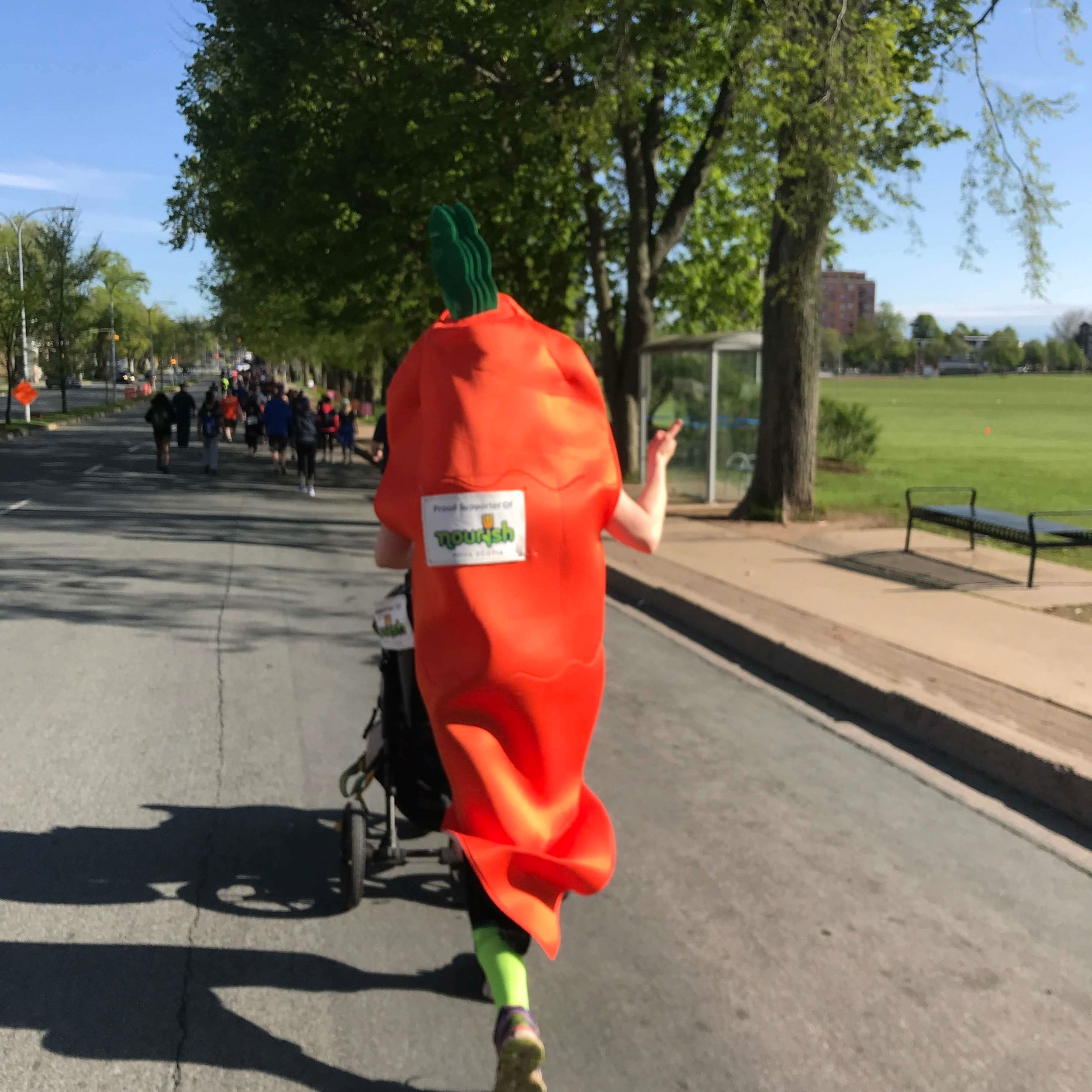 Our mascot, Crunchy the Carrot giving their all!