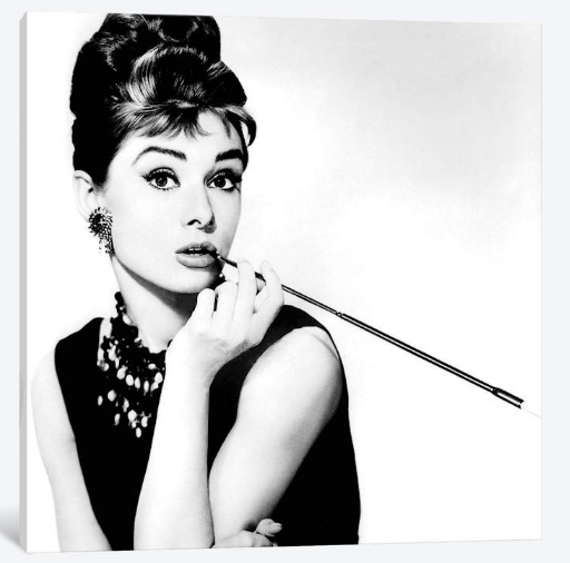 iCanvas - Canvas - Audrey Hepburn Smoking  Audrey Hepburn Smoking captures the world-renowned actress and humanitarian's gamine innocence and innate sophistication as she poses with a slim cigarette holder. A stunning black and white print that complements interior décor of all kinds, it's particularly suited to contemporary living spaces. Whether you're a Hepburn devotee or a dedicated follower of fashion, this work will give your living room wall or entry alcove a classic, timeless twist.